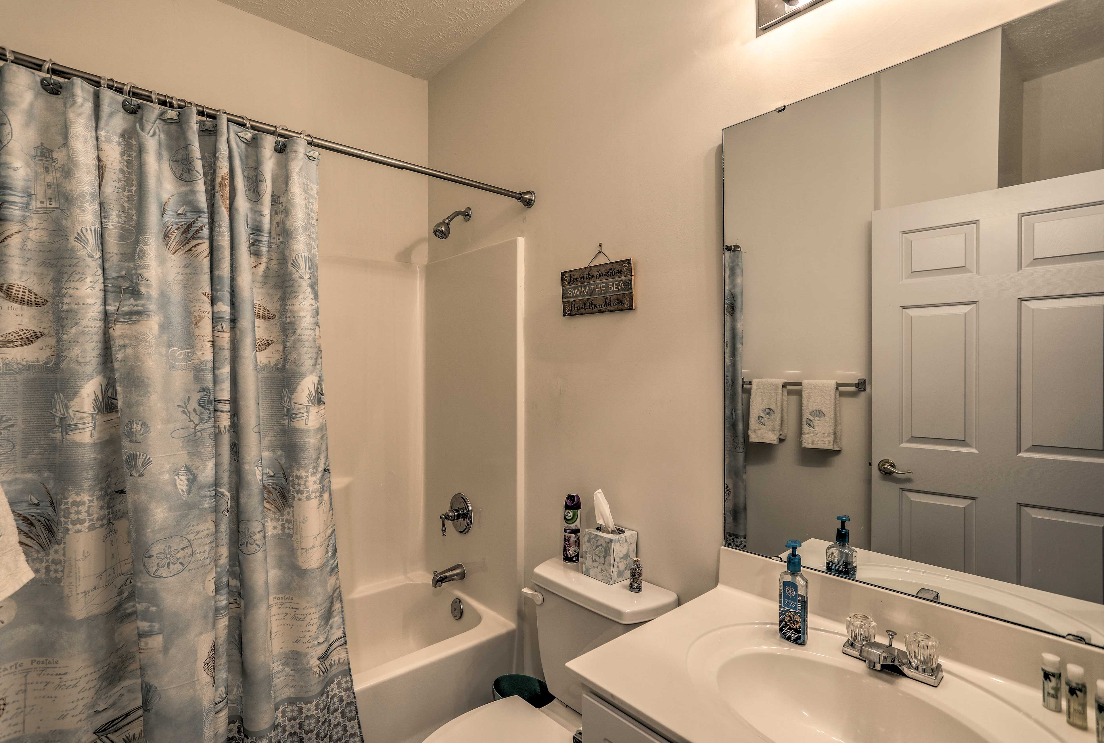 Rinse off the salt and sand in this shower/tub combo.