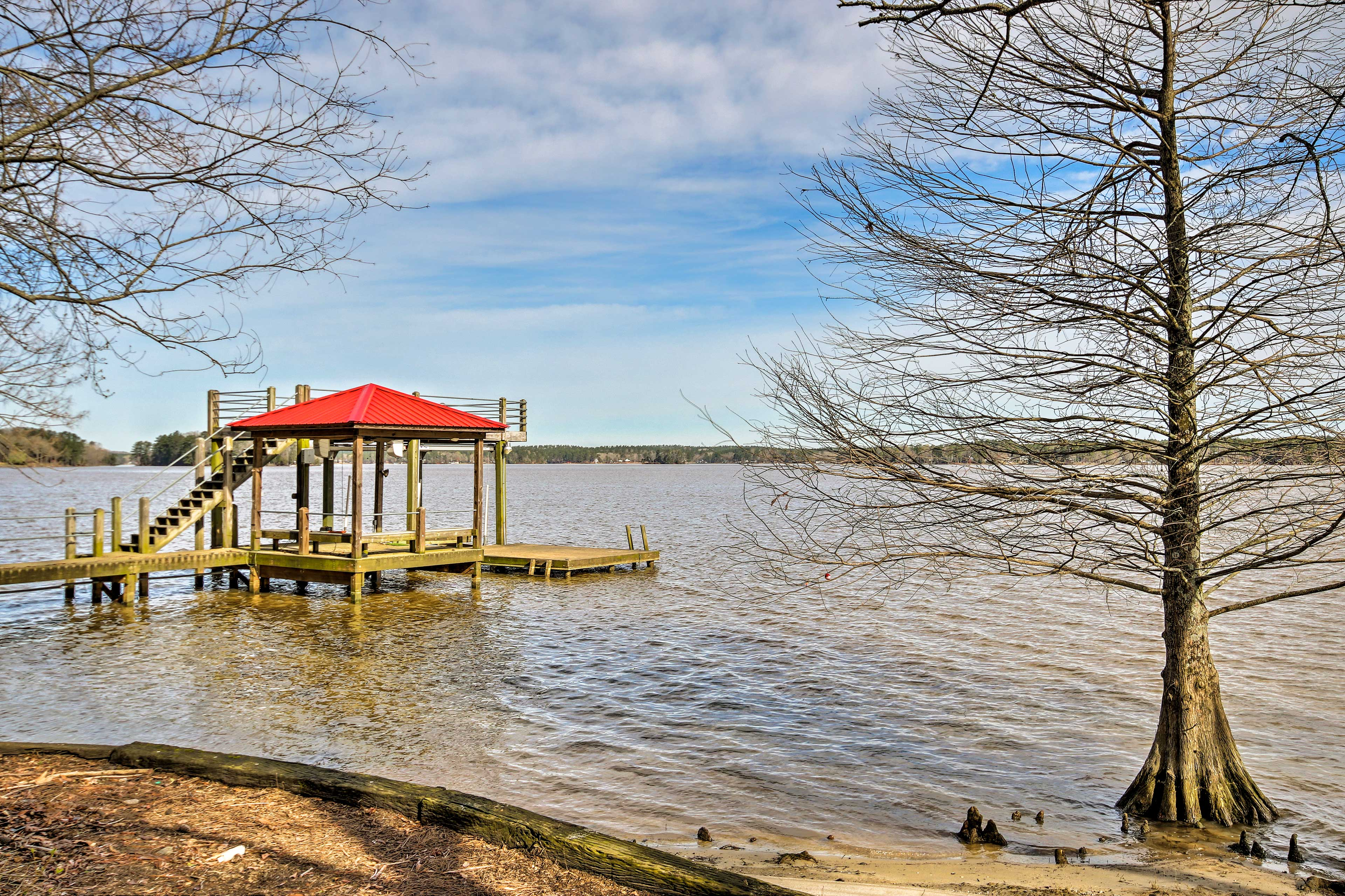 The vacation rental home is located on Lake Wateree and has a private dock!