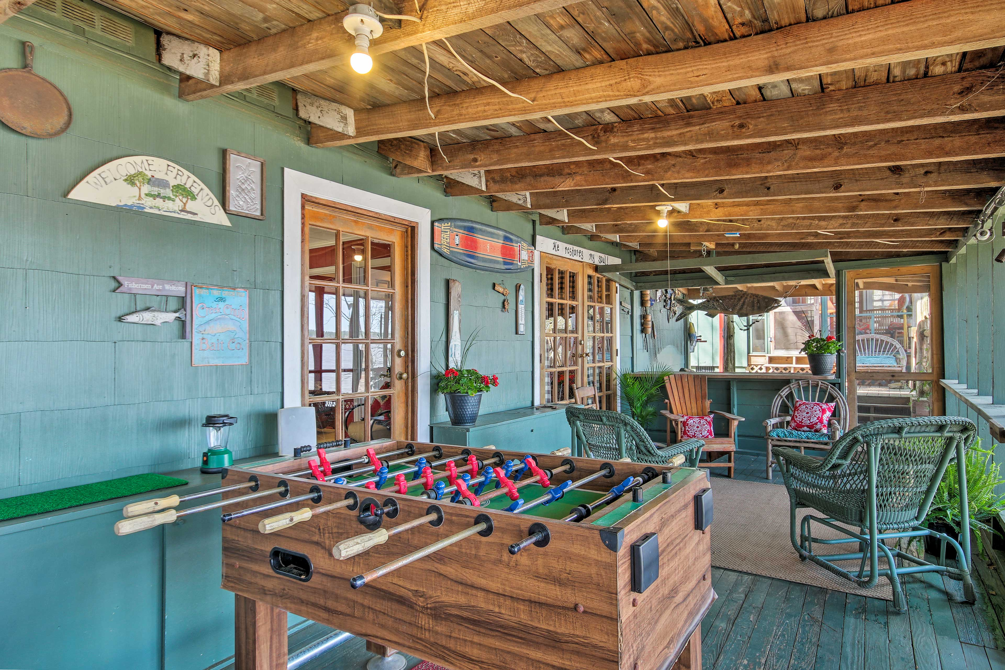 The guest house has a covered porch with a Foosball table!