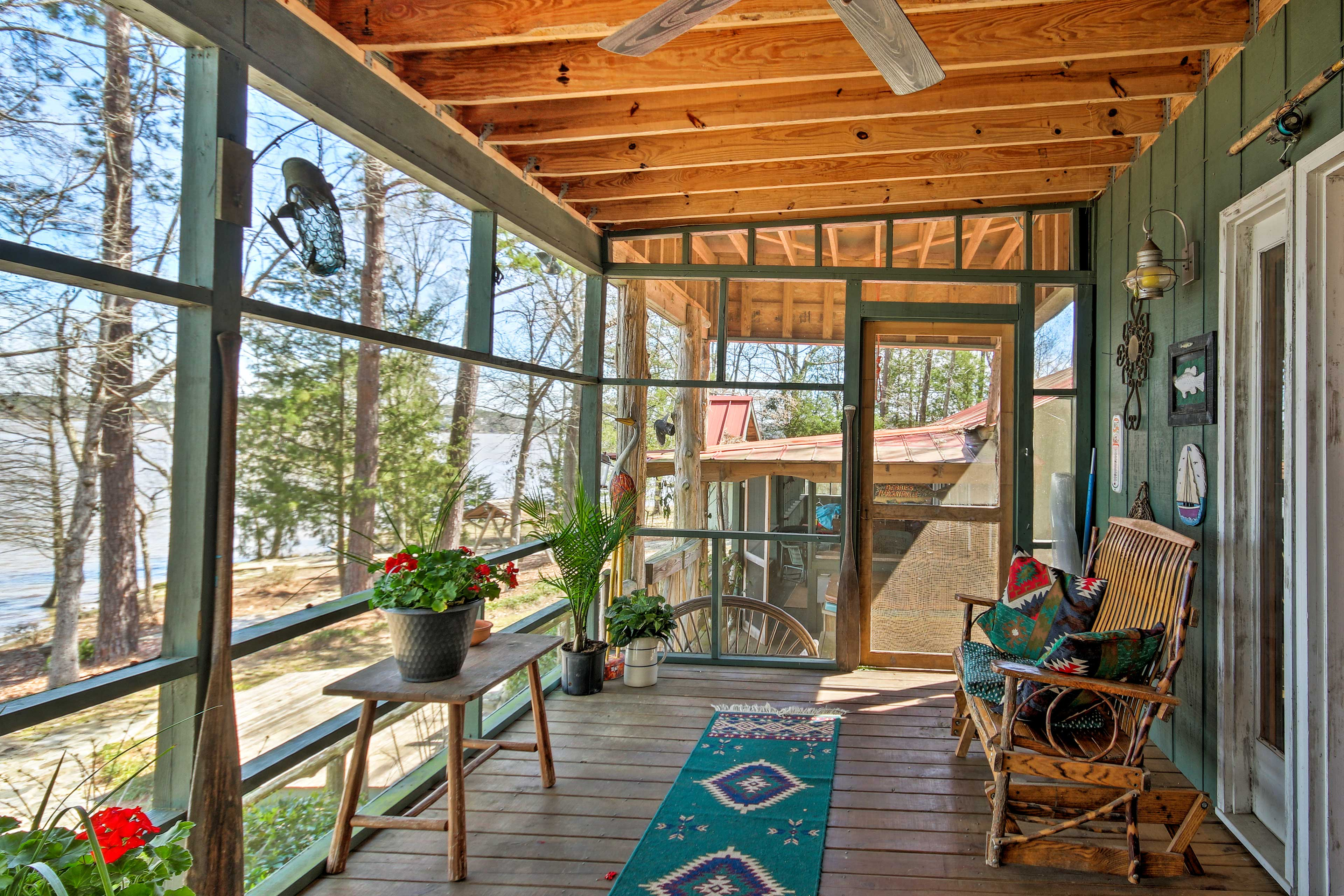 The covered porch has a lake views.