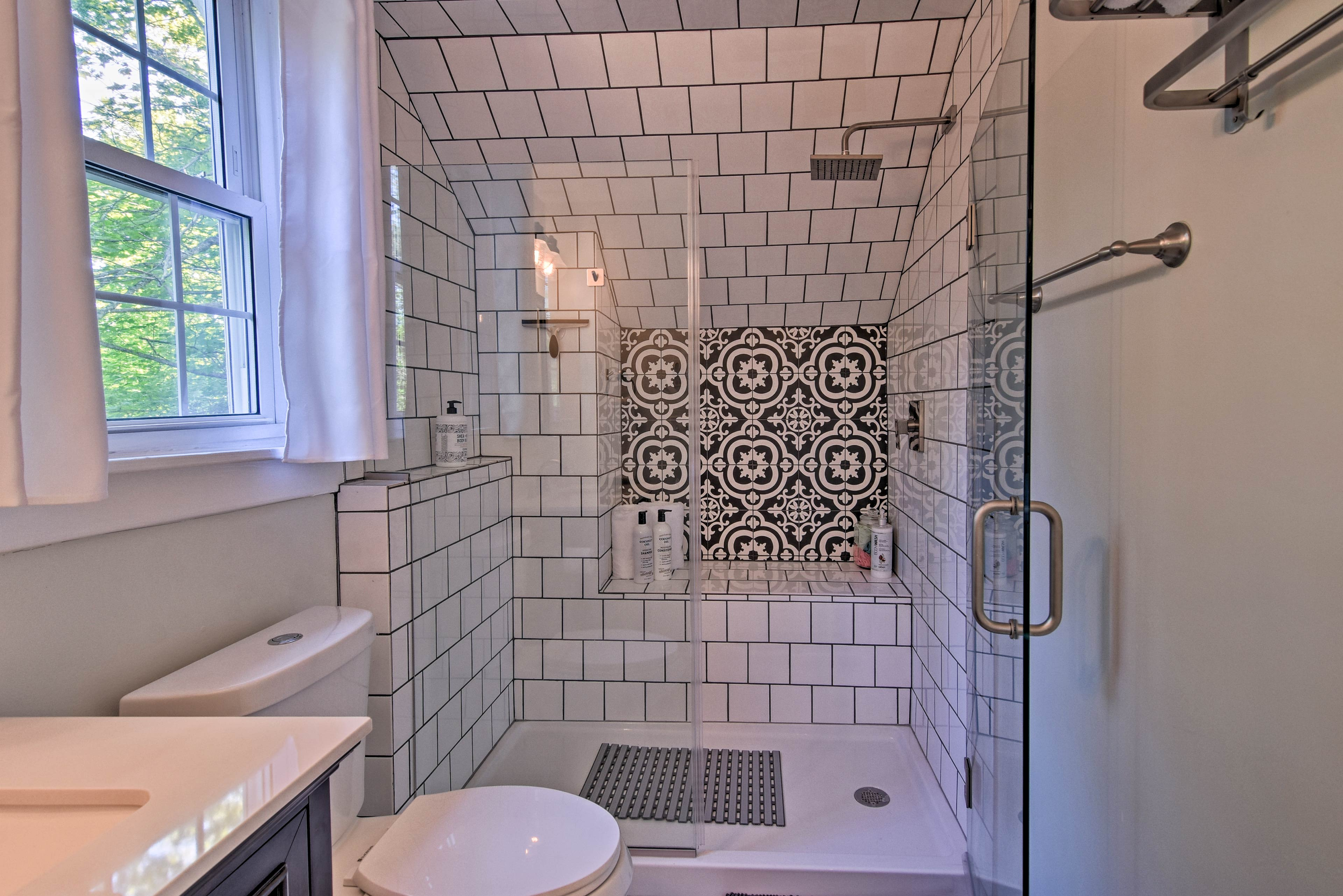 Rinse off in the spacious and decorated walk-in shower.