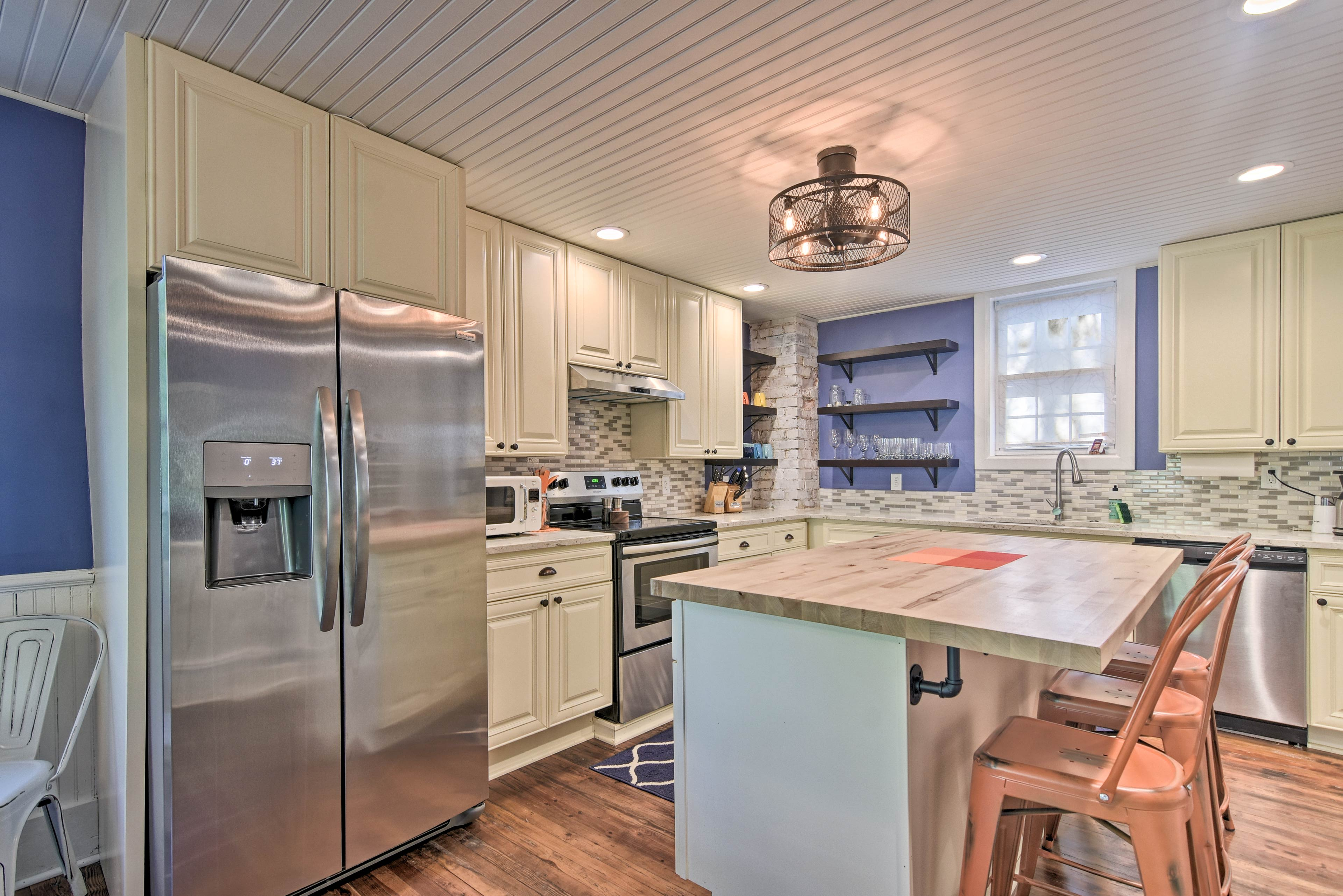 The space is outfitted with stainless steel appliances.