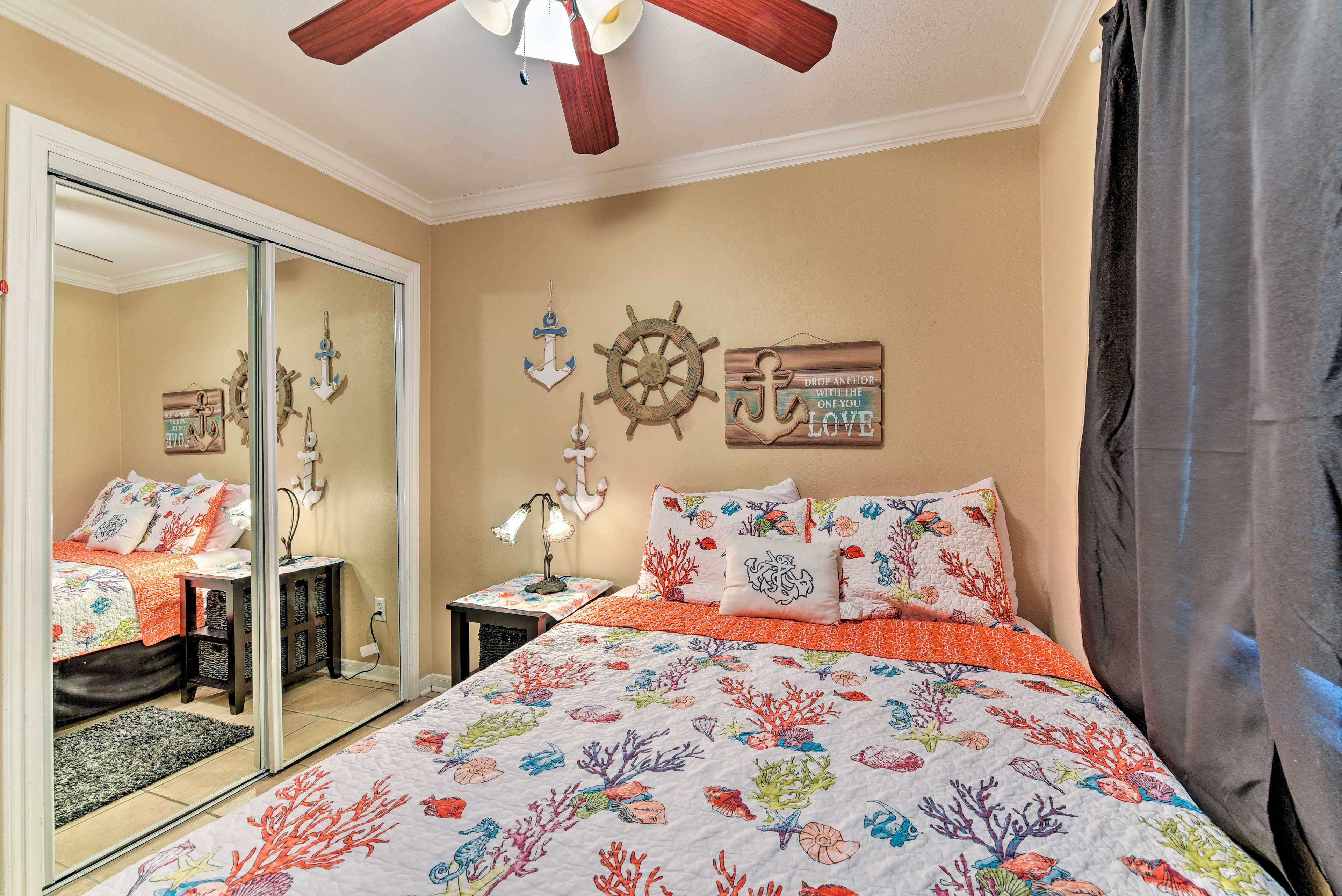 The bedroom features a queen bed, closet, and ceiling fan.