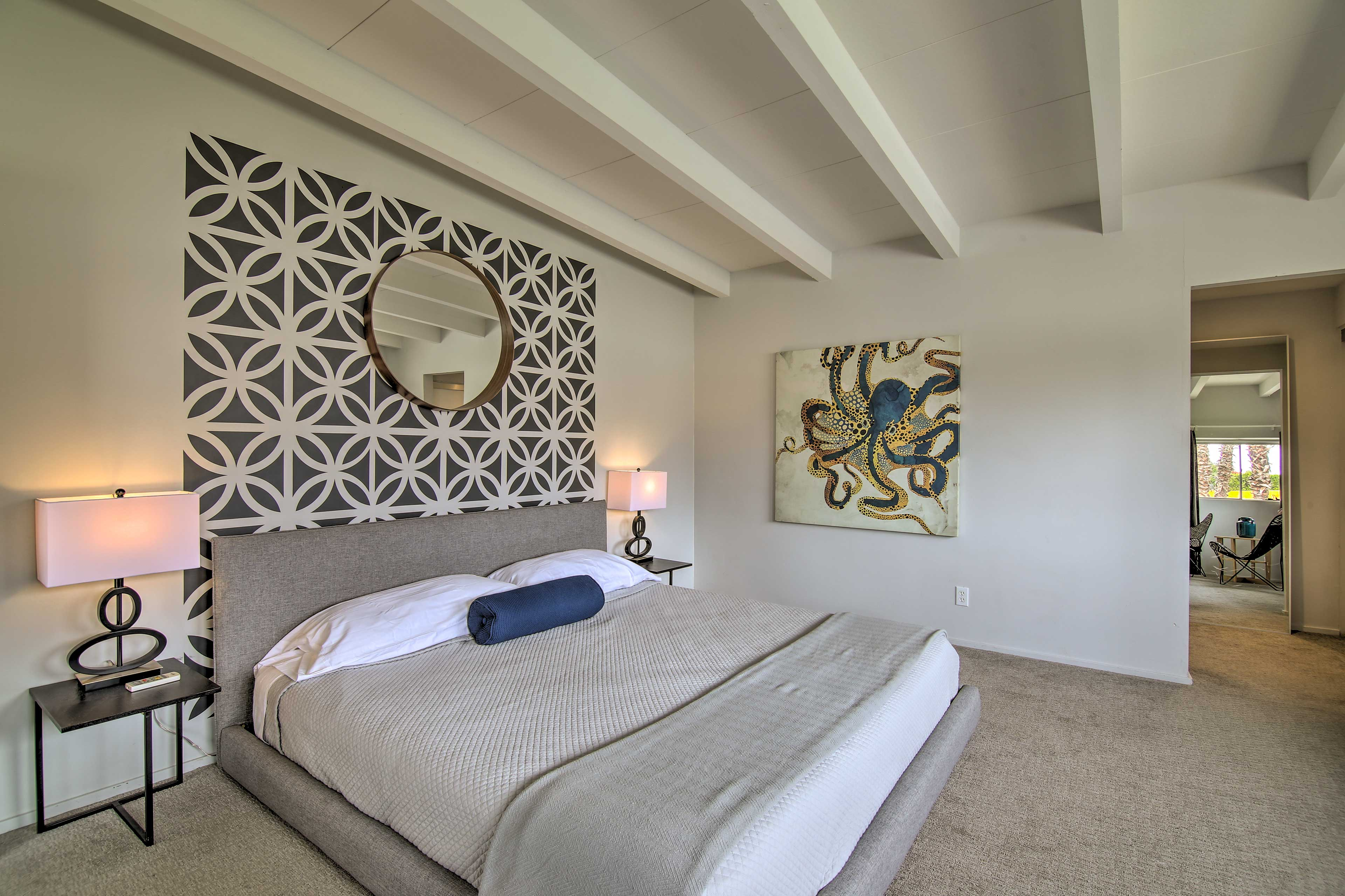 The master bedroom boasts a luxurious king bed.