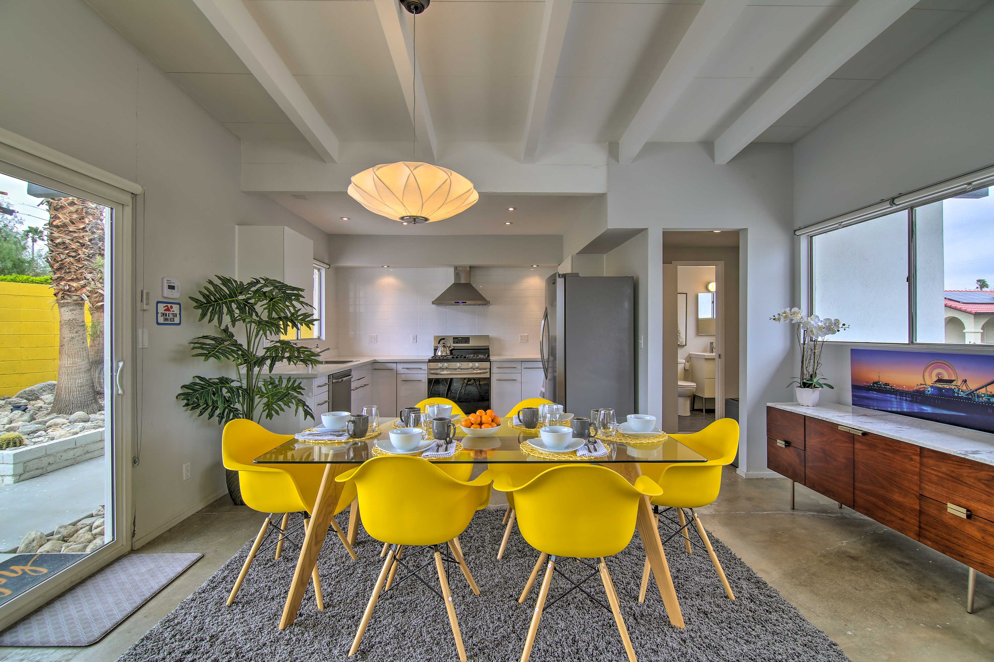 The dining area seamlessly flows into the kitchen.