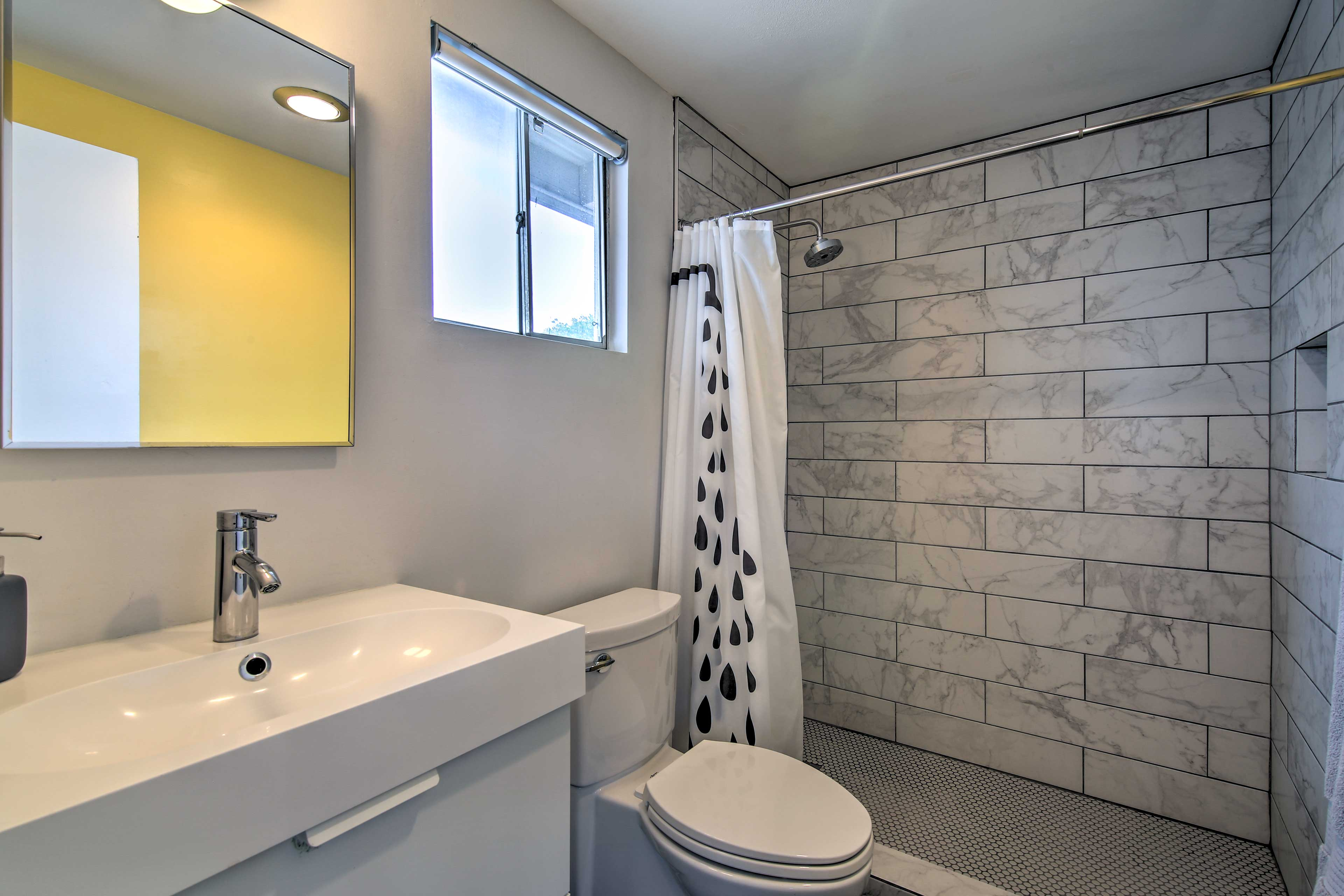 The second full bathroom offers a pristine walk-in shower.