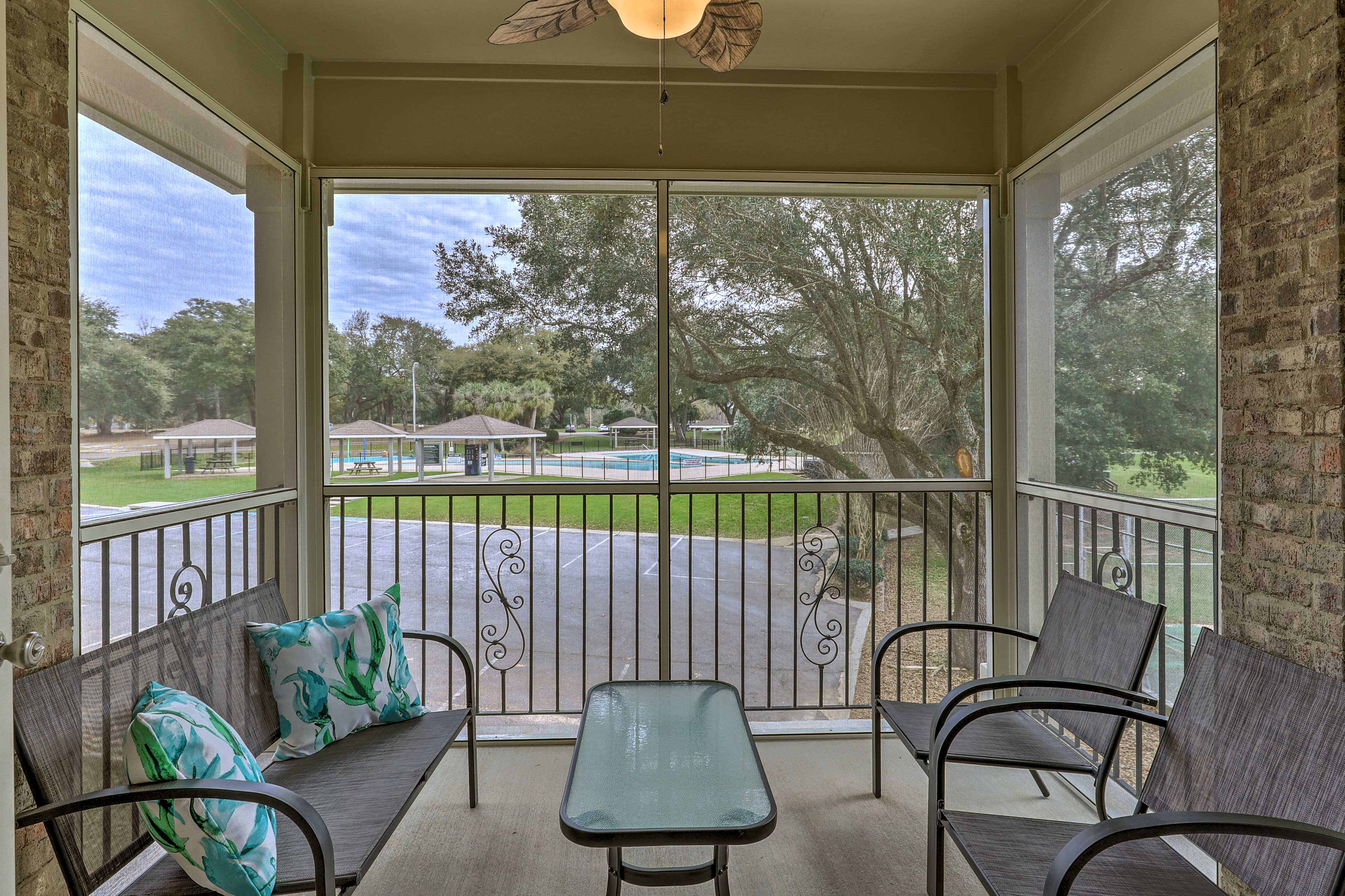 This vacation rental boasts a screened-in patio overlooking the pool area!