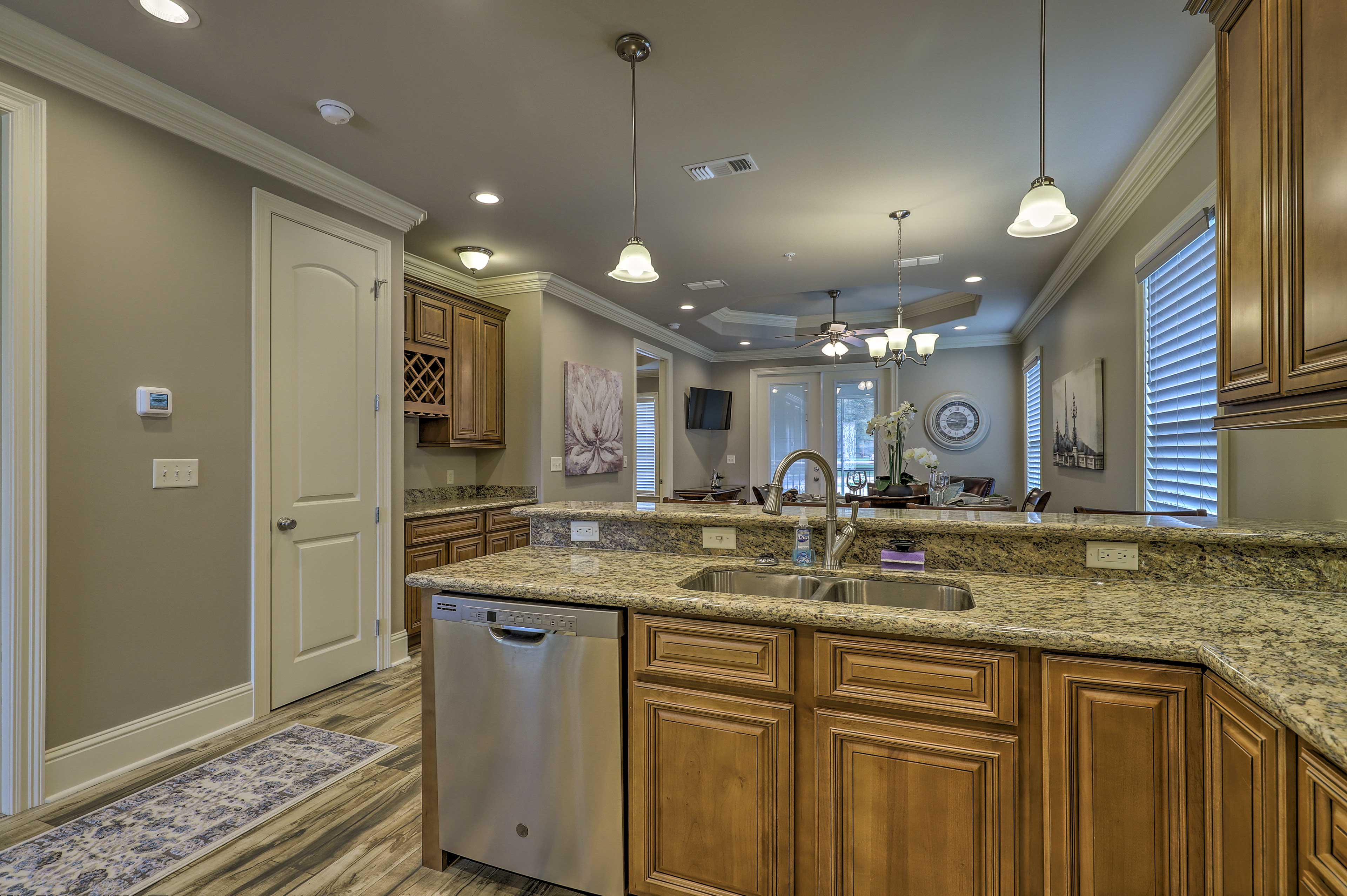 Sleek granite counters complete the kitchen.