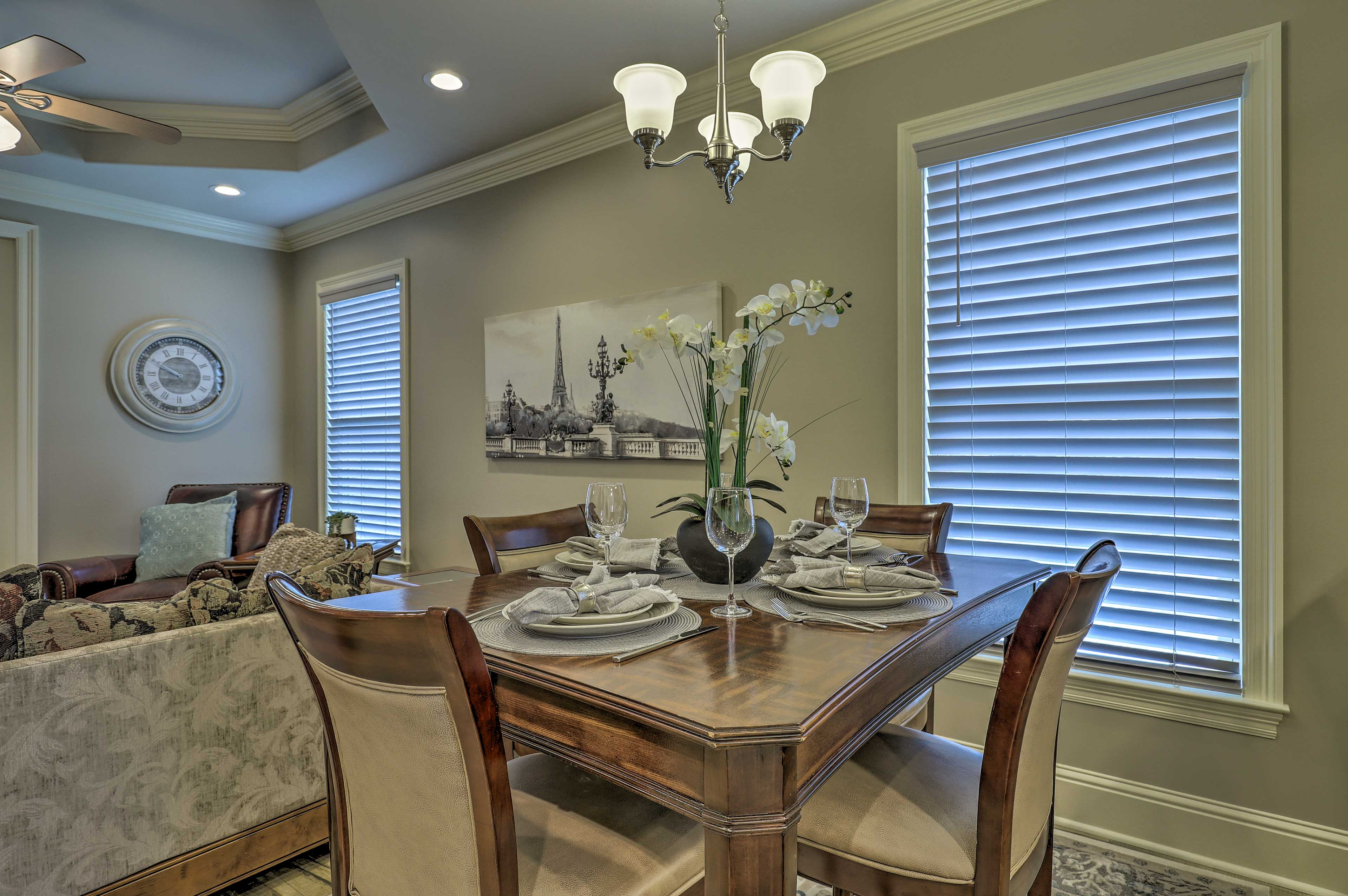 The dining table sits between the kitchen and living area.