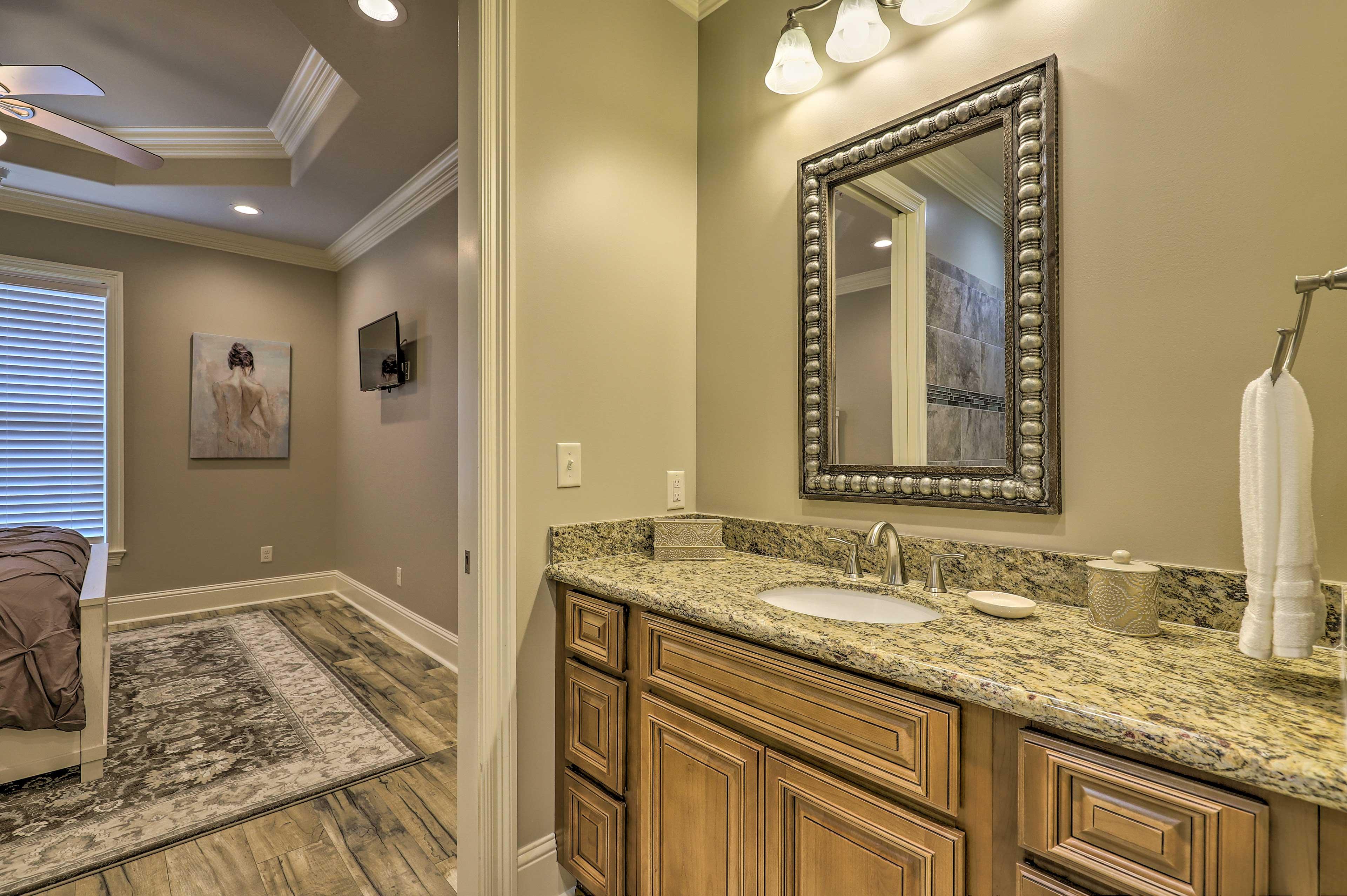 The en-suite features a large vanity.