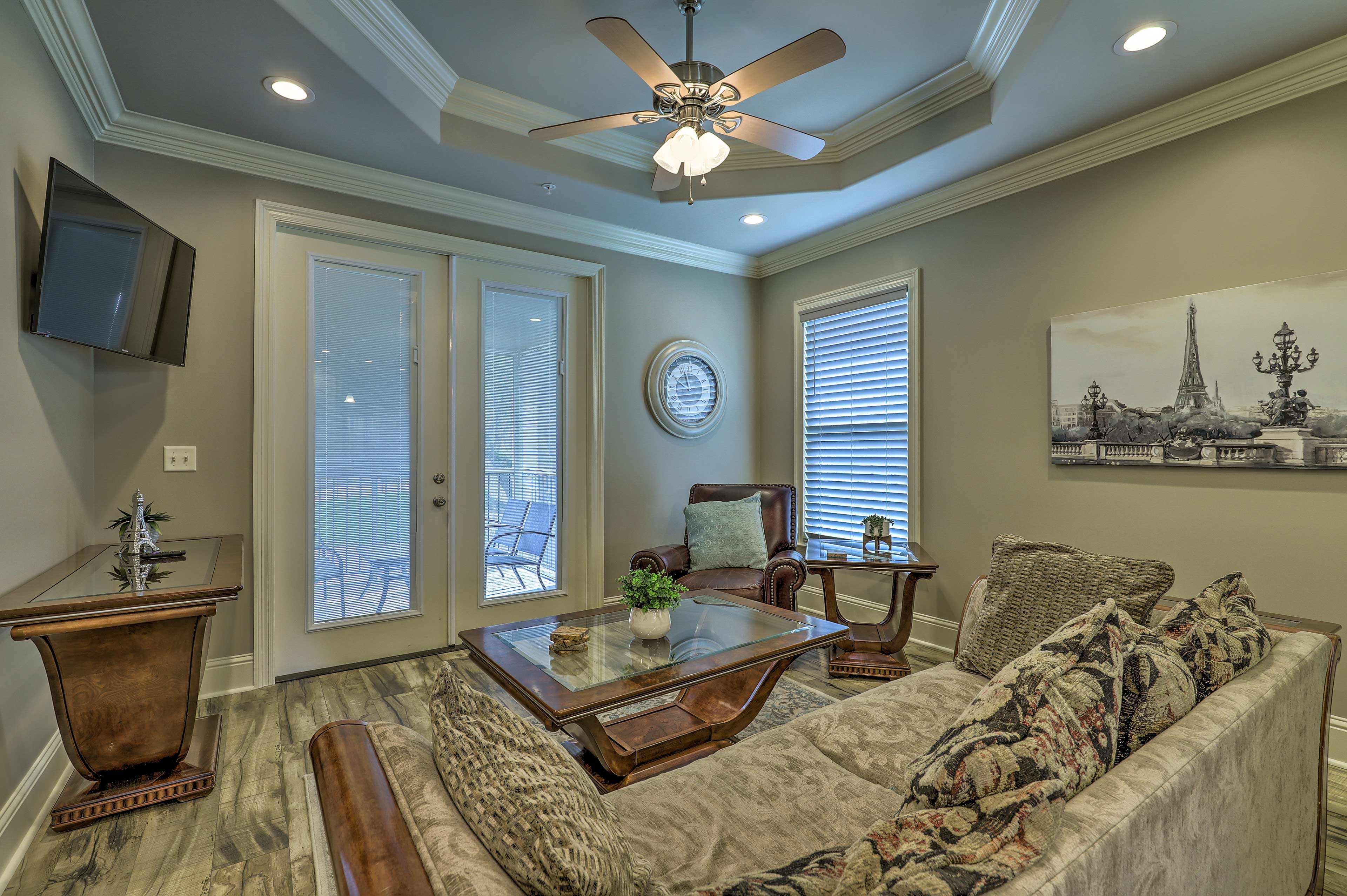The living room features comfortable furnishings.