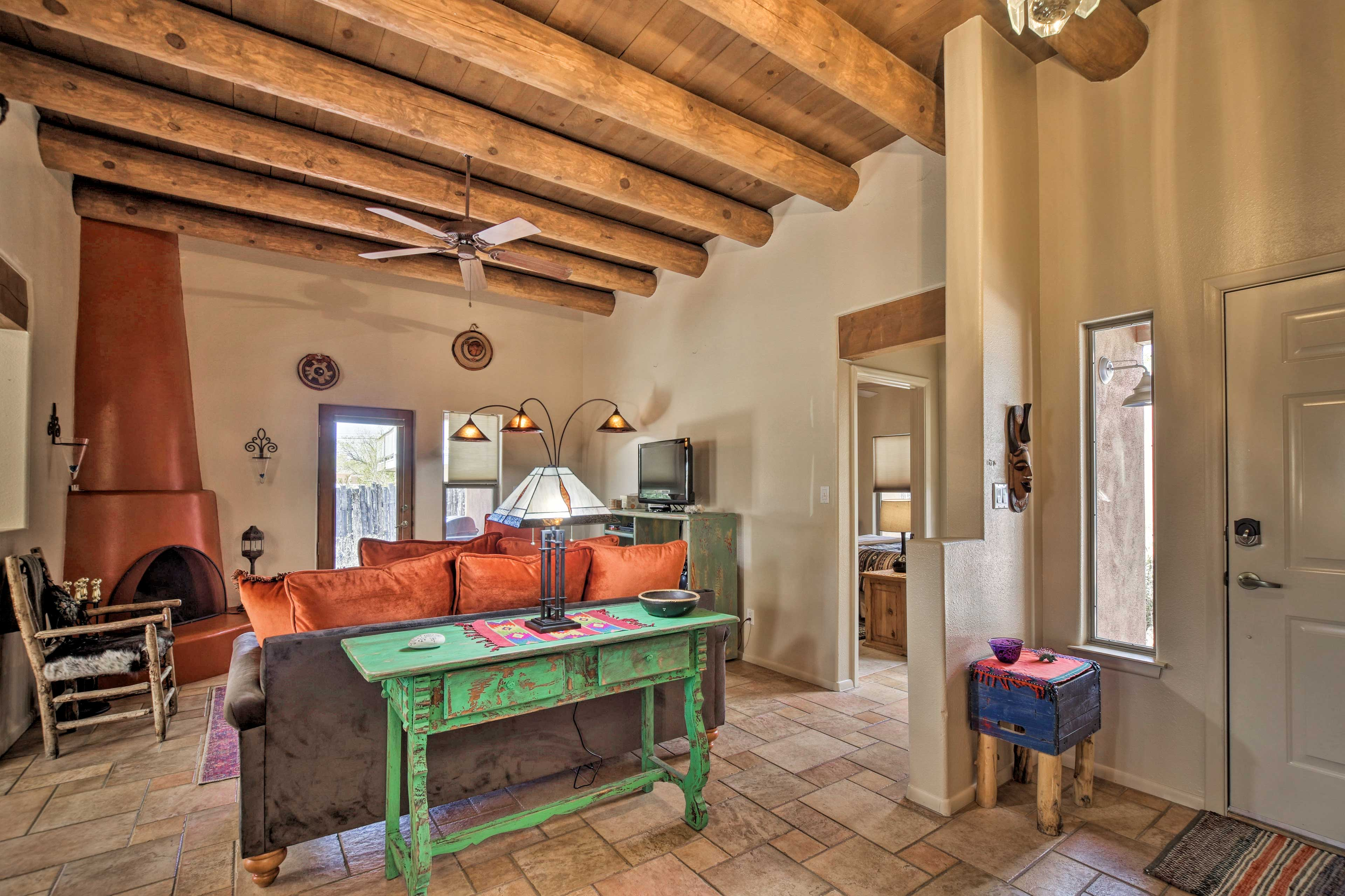 The interior features exposed wood beams and tasteful decor.