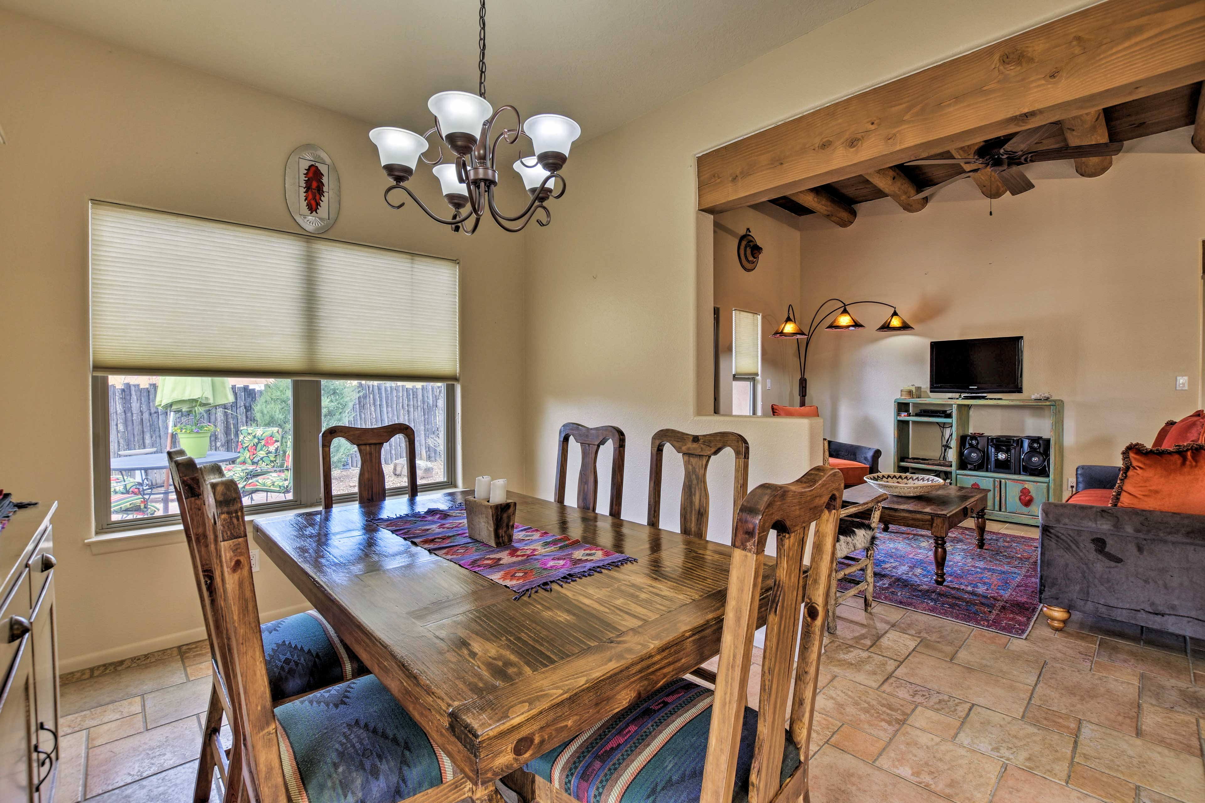 Gather at the 6-person dining table to savor meals.
