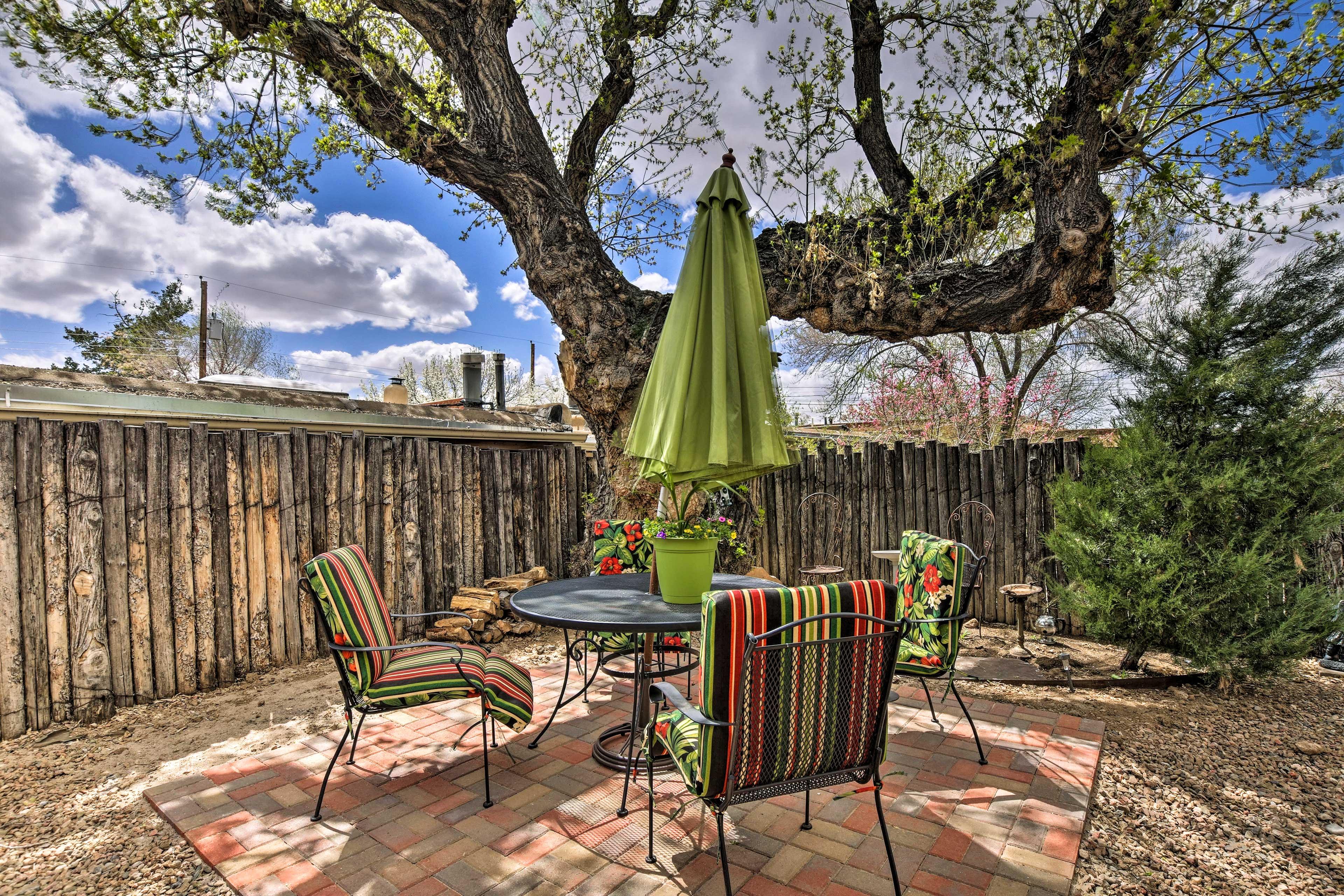 Dine al fresco and put up the umbrella for shade.