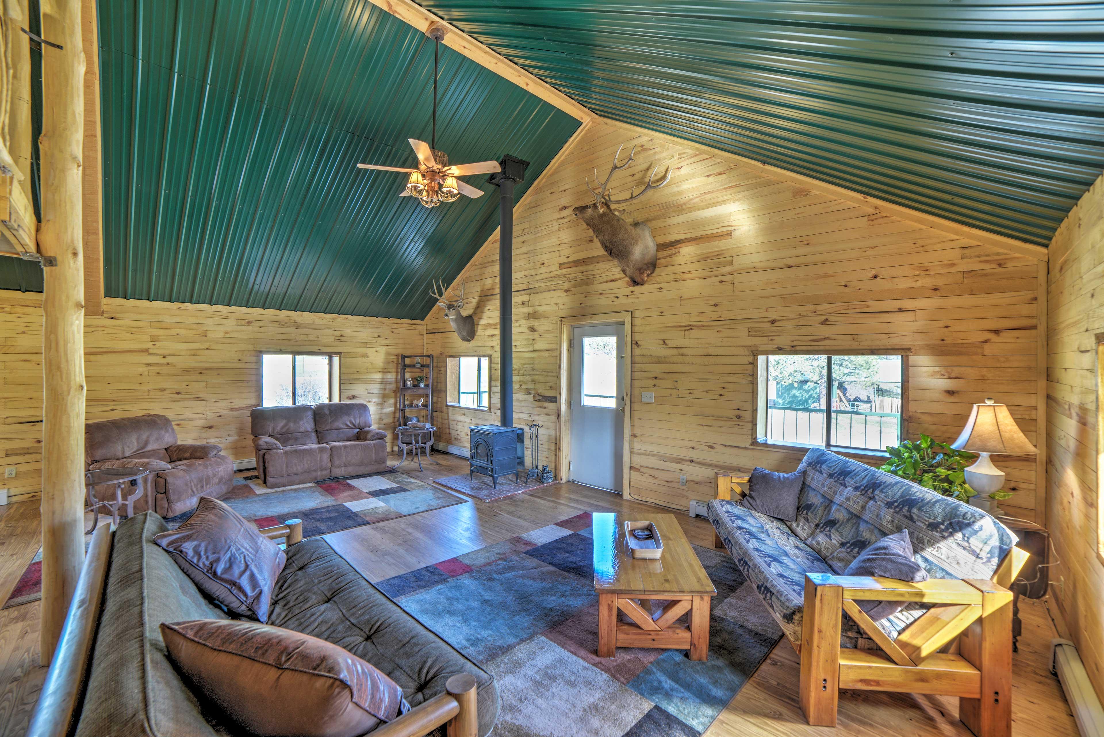 Living Room | Wood-Burning Stove | Rustic Furnishings | Ceiling Fan