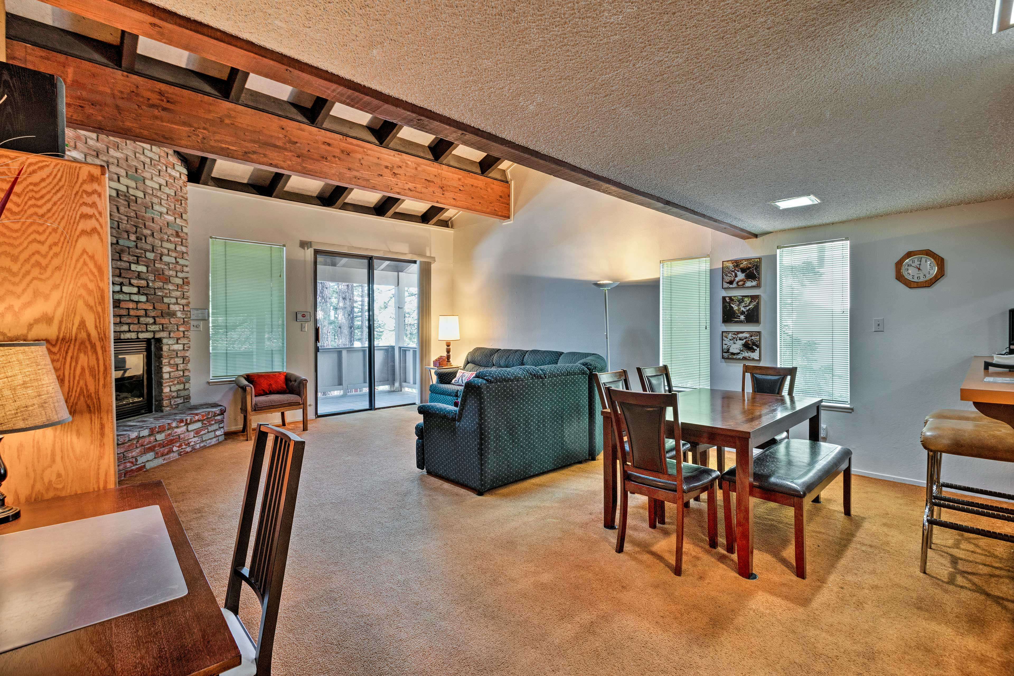The living space includes a work space and dining table with room for 6.