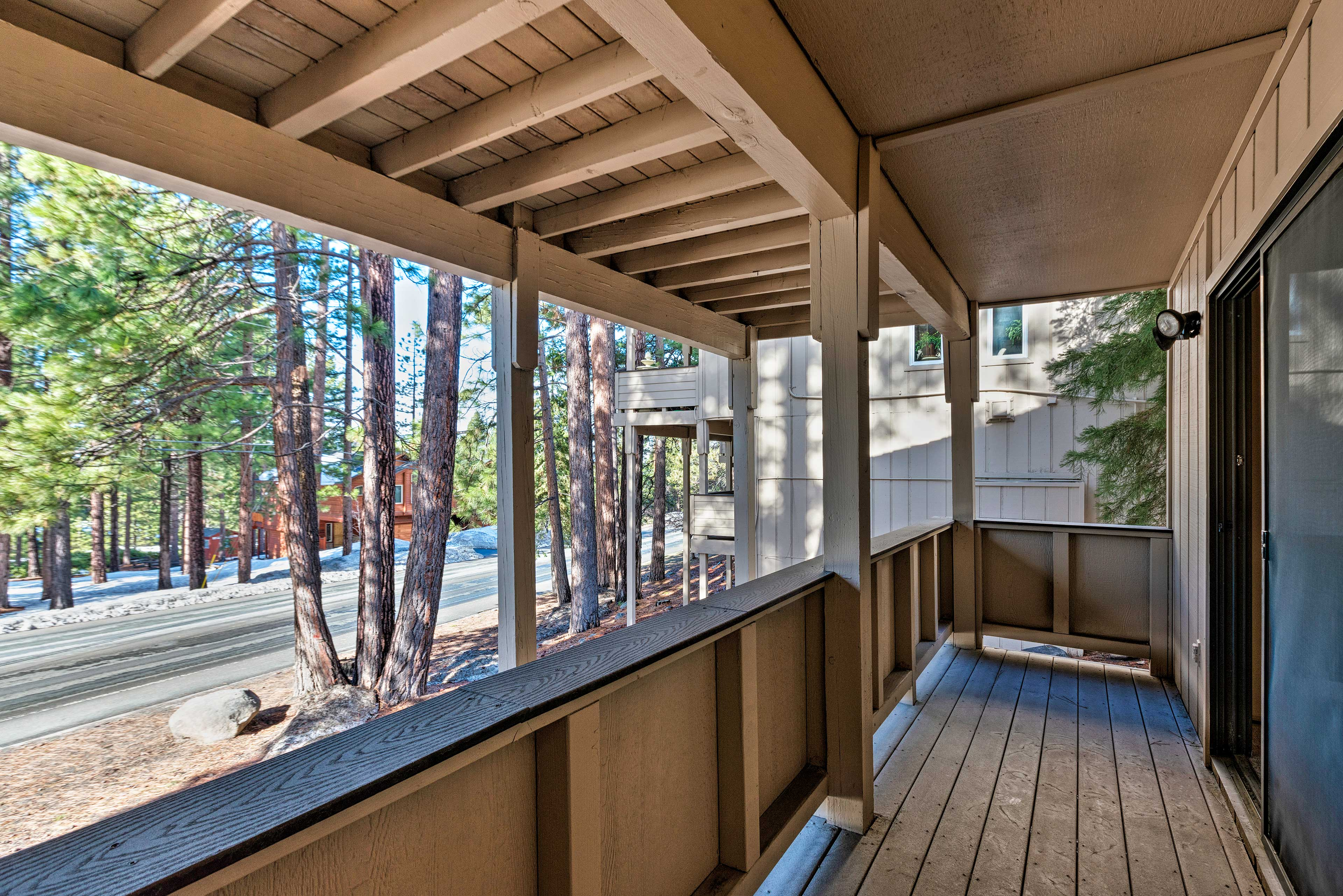 Enjoy the fresh air and wooded views from the deck.