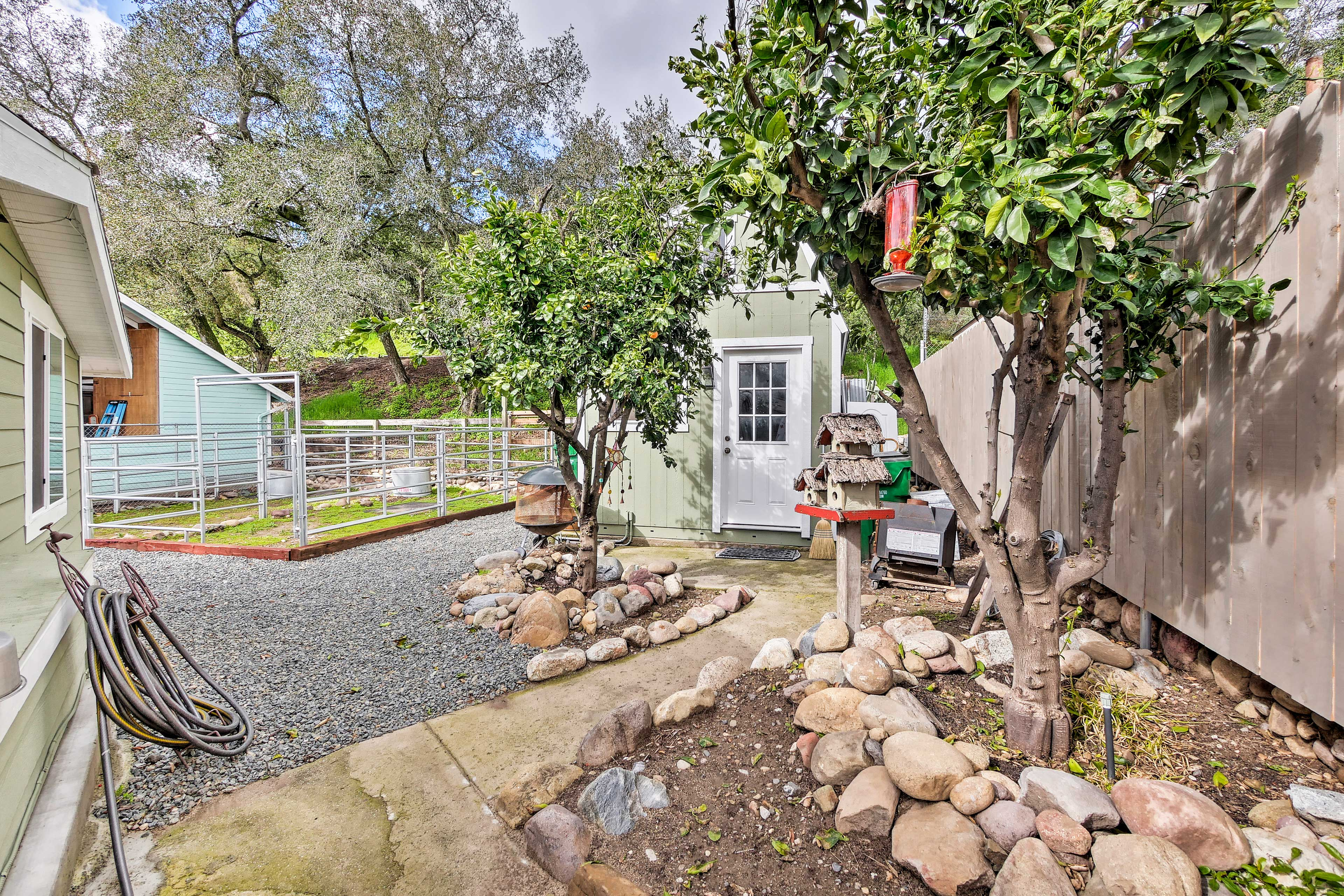 Charming landscaping surrounds the cottage.