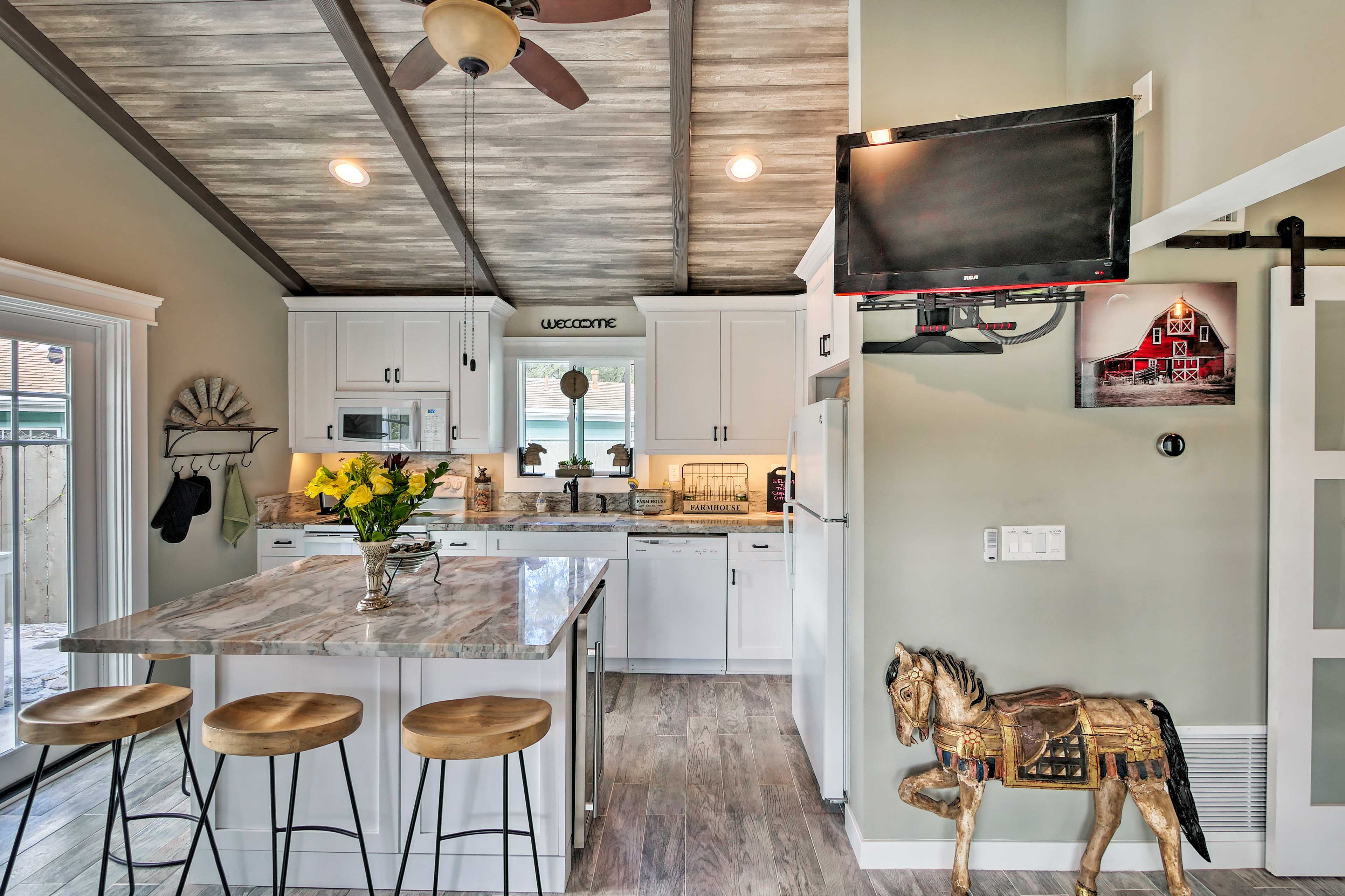Pull up a barstool to the kitchen island.