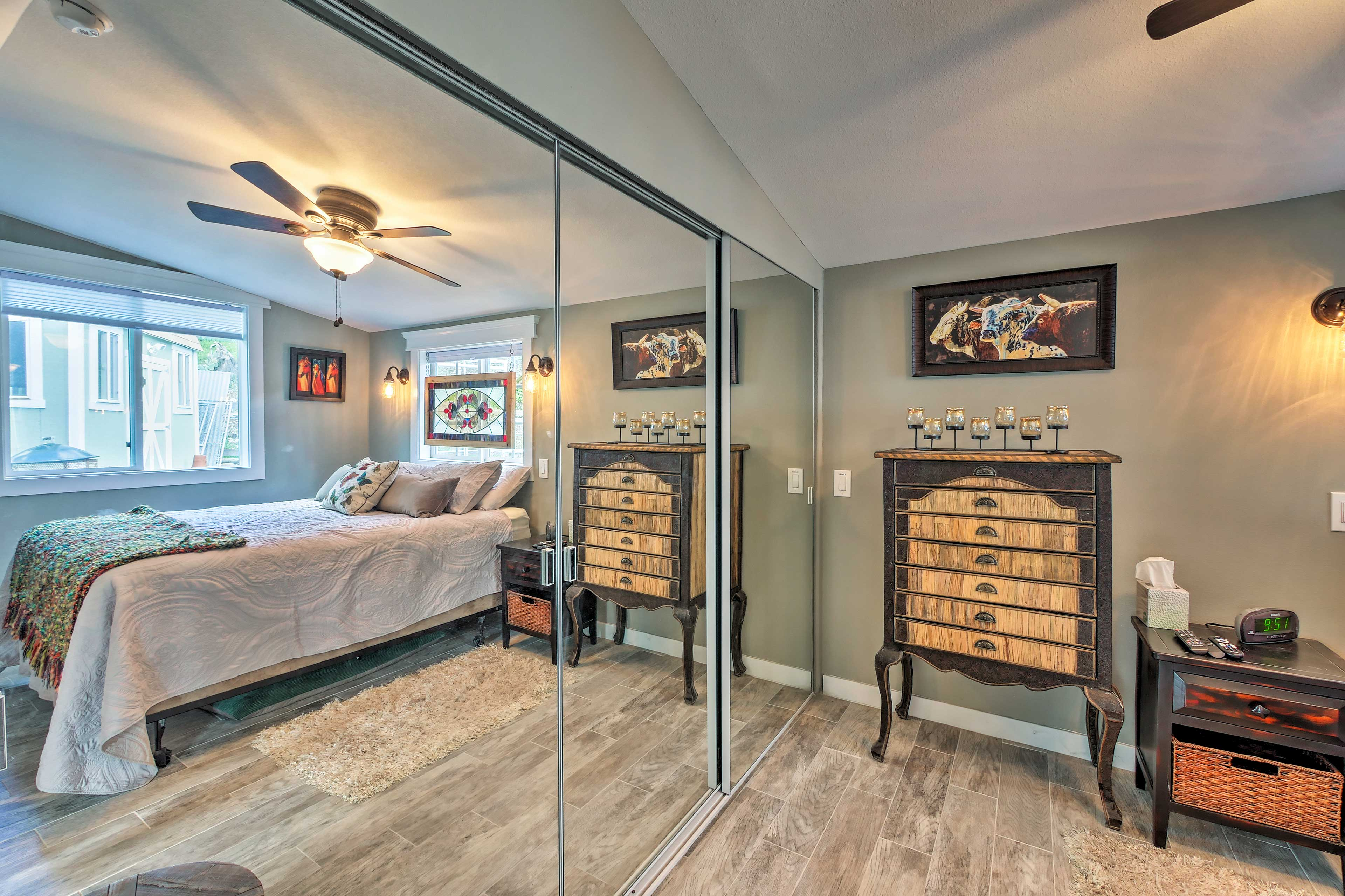 There's plenty of storage in the double mirrored closet.