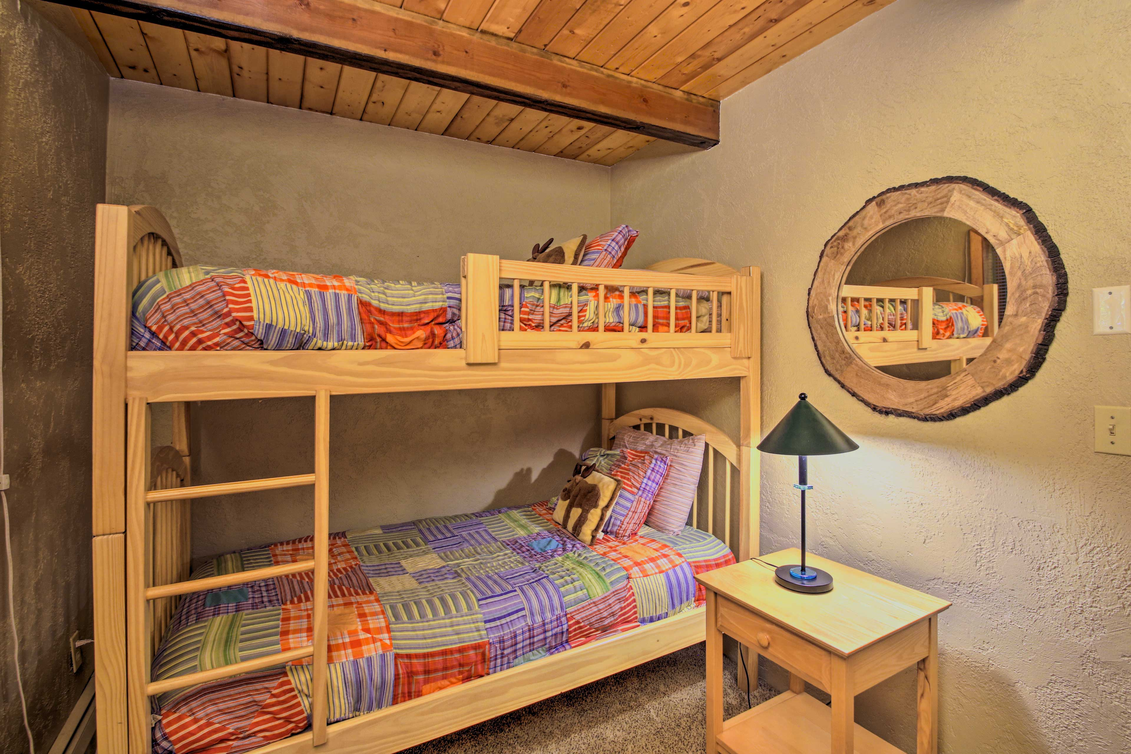 The kids will like the twin bunk bed in this room.
