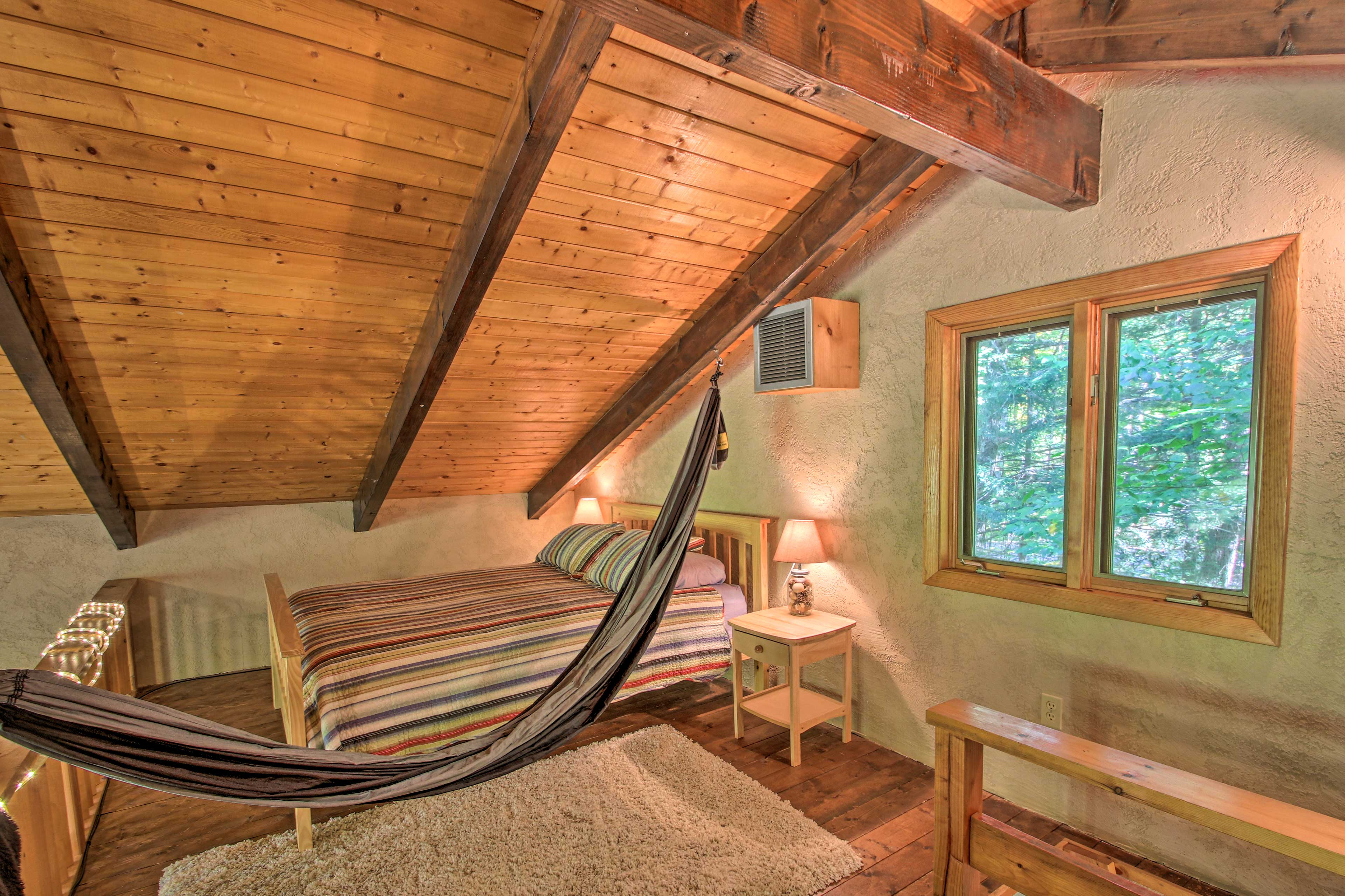 Head up to the loft, where you'll find a queen bed.