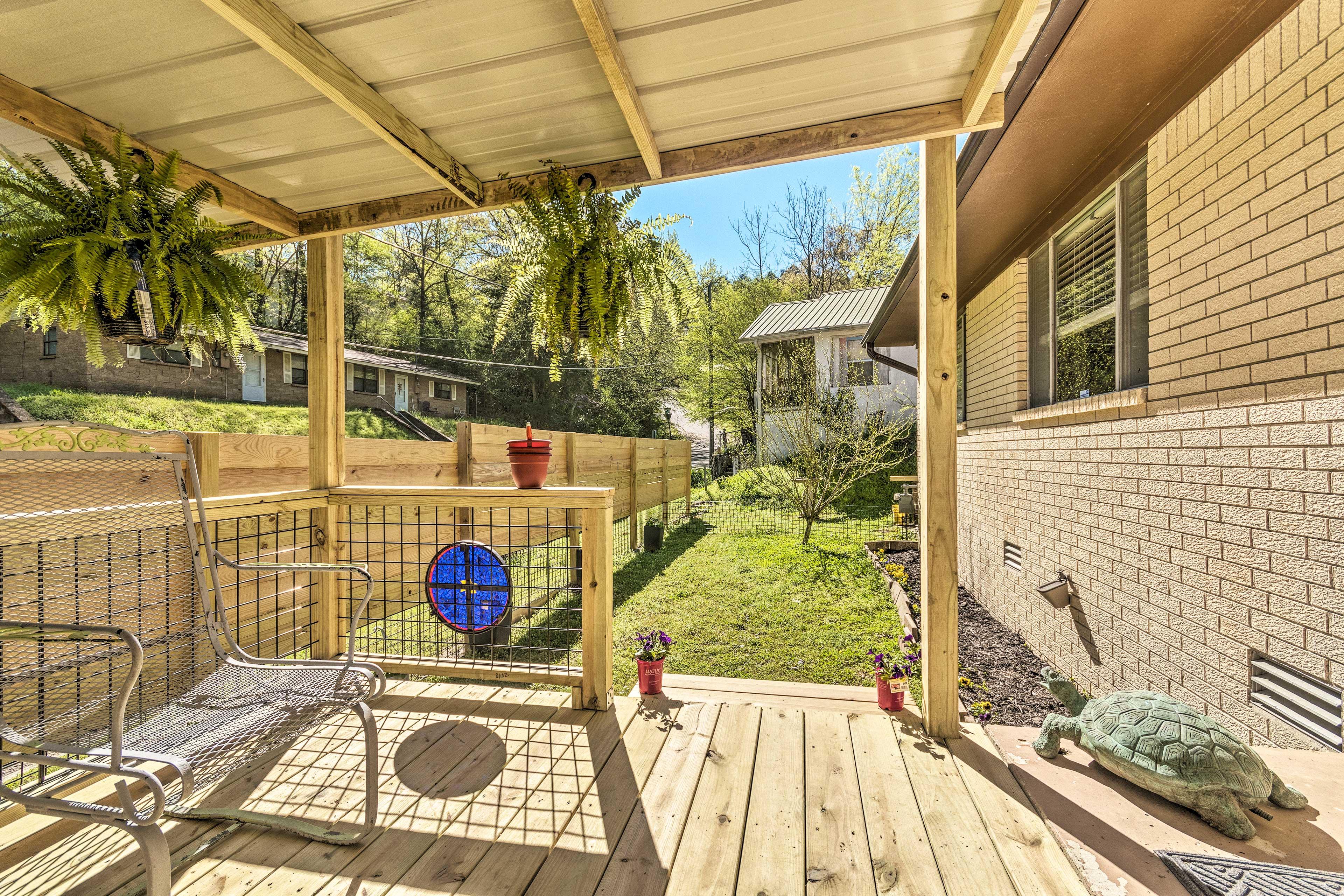 Soak up the sun in the backyard.