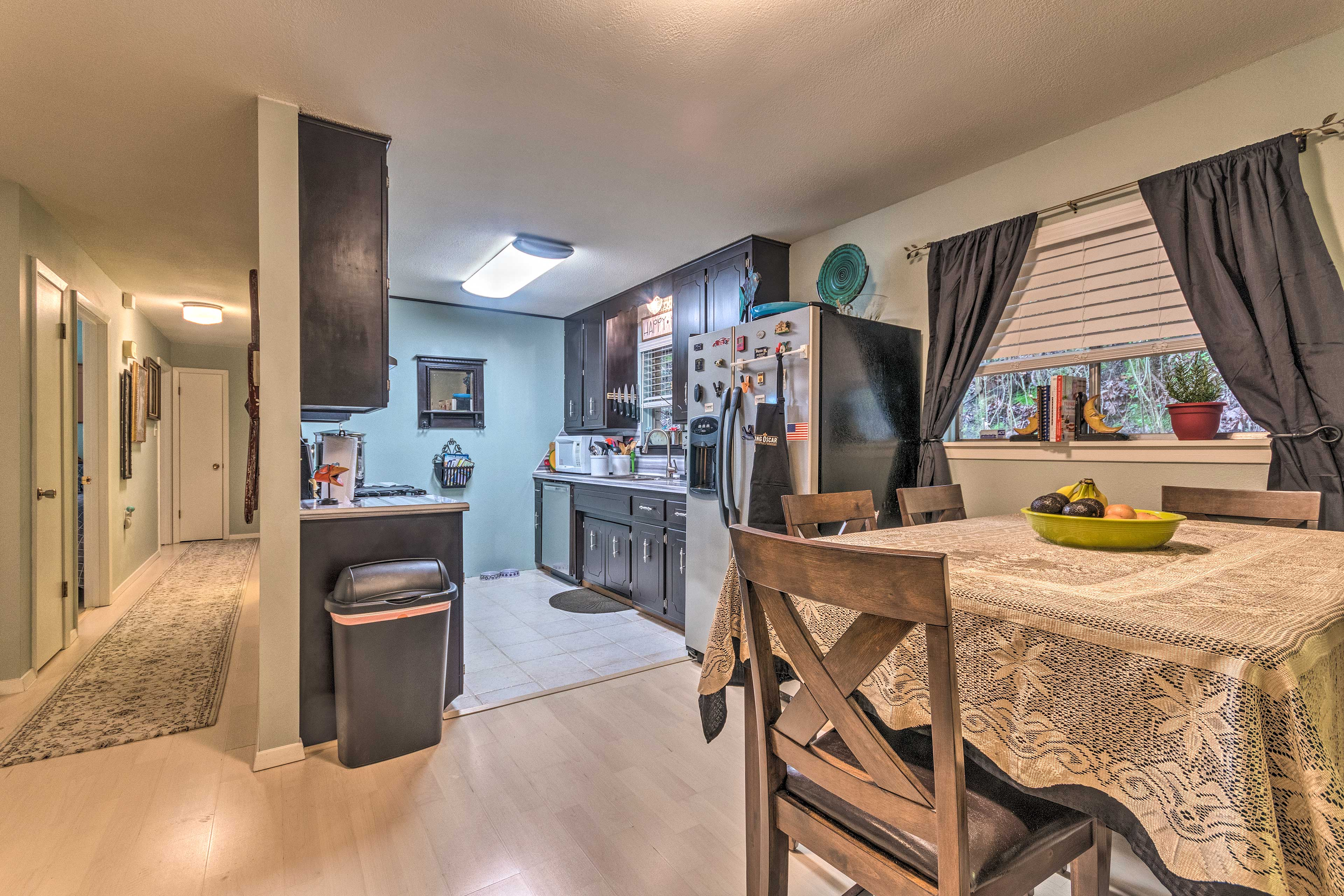 The fully equipped kitchen is steps from the dining table.