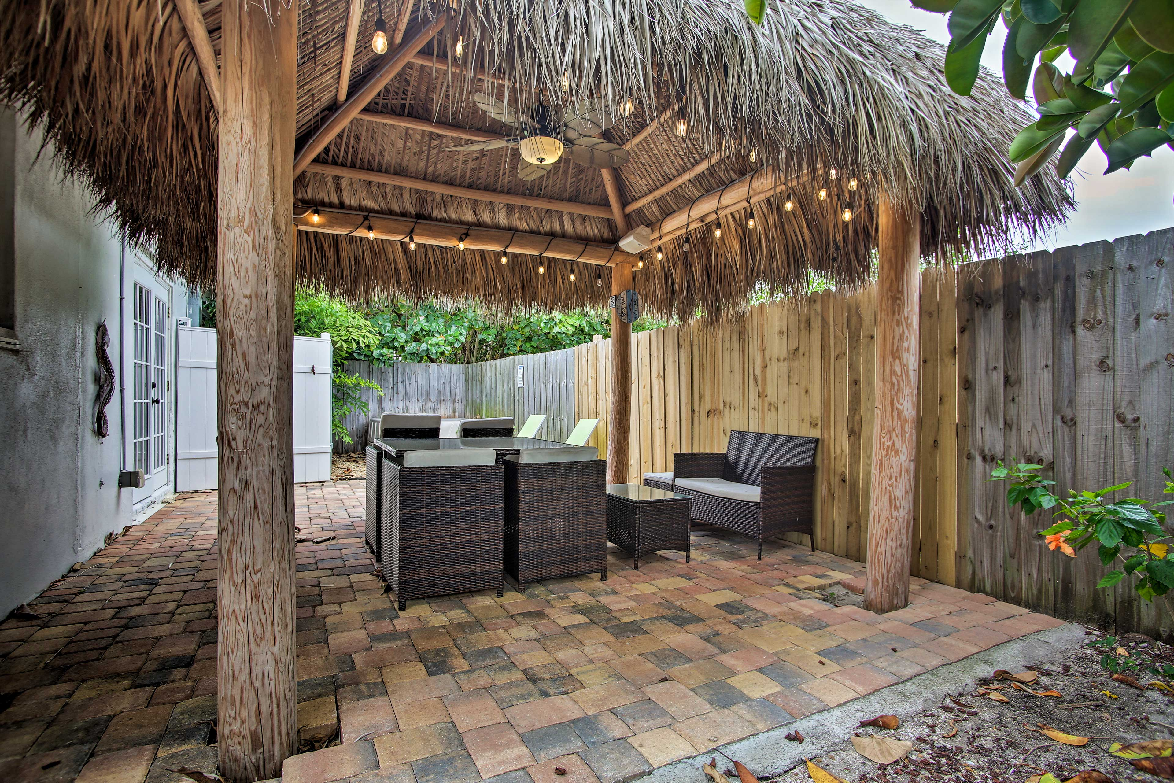 The vacation rental has a tiki hut with Bluetooth Speakers!