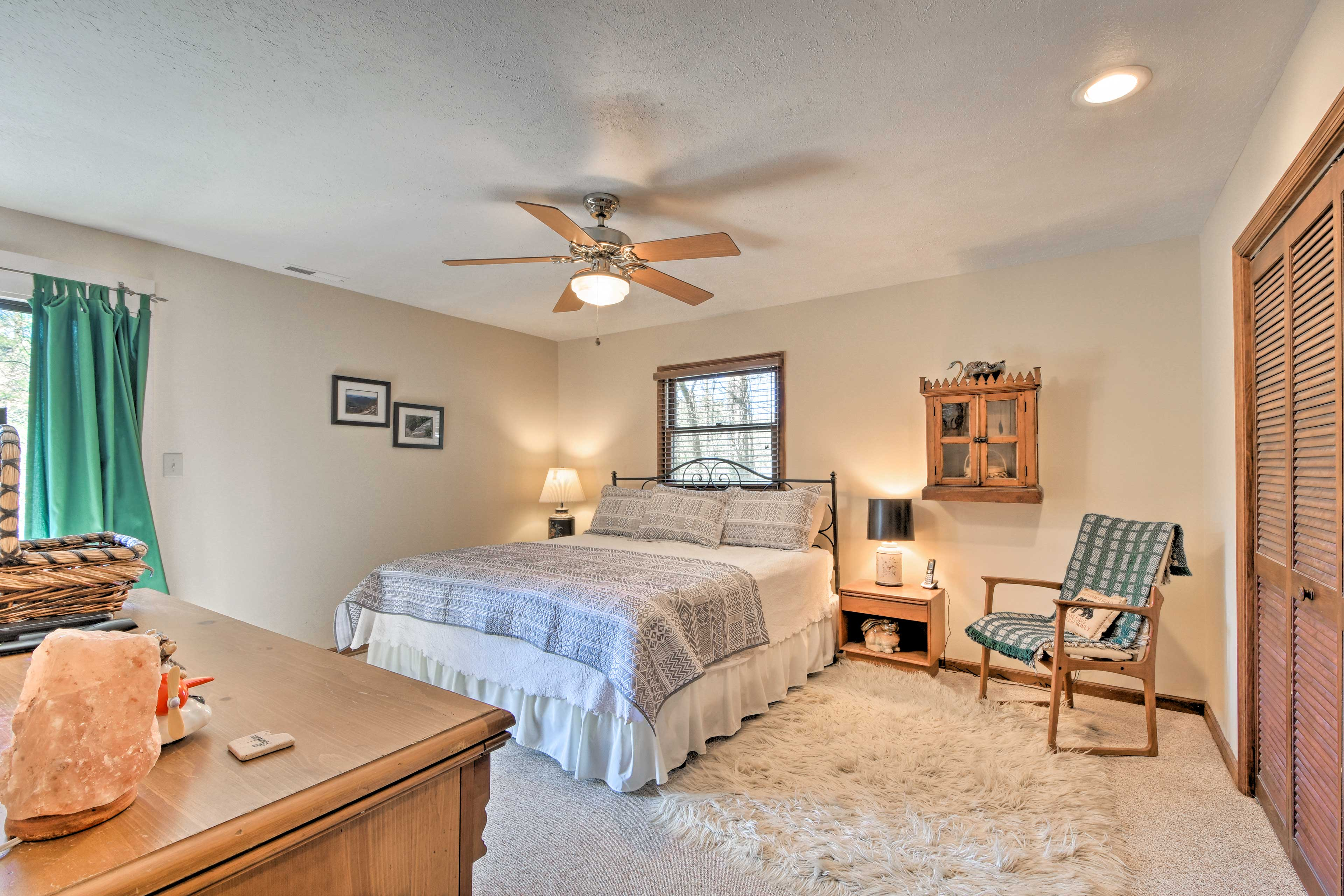 Claim the master bedroom's king bed as your own!