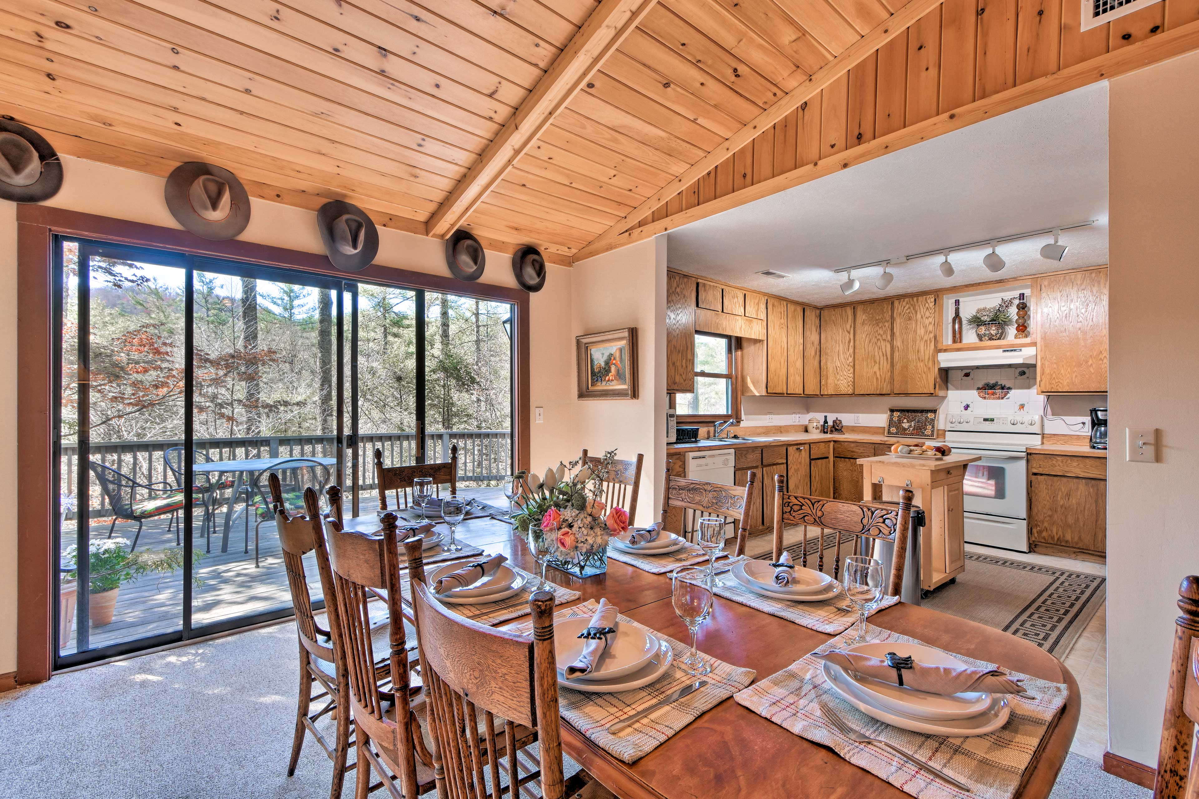 The living area flows seamlessly into the fully equipped kitchen.