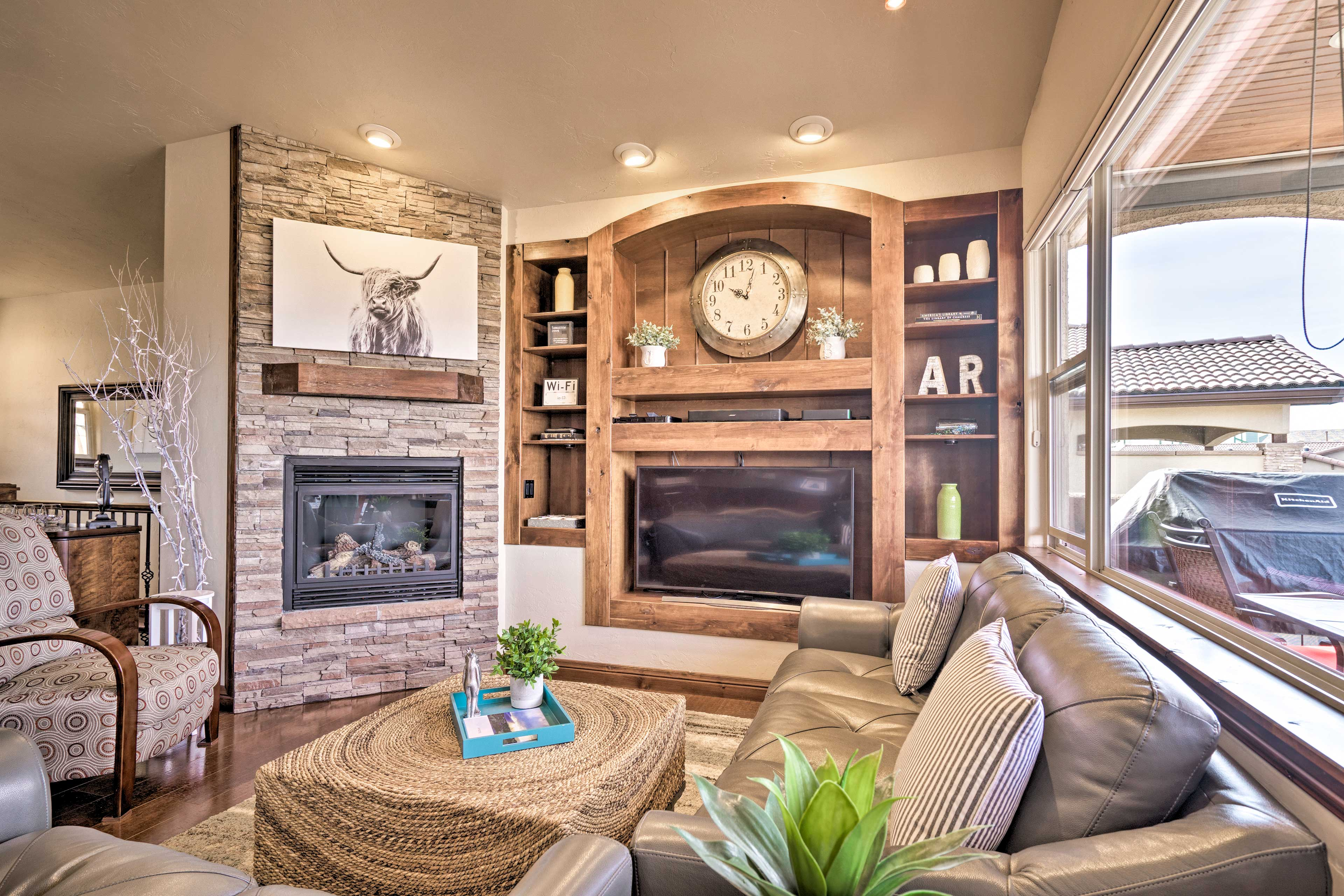 The upstairs living room includes a flat-screen TV and gas fireplace.