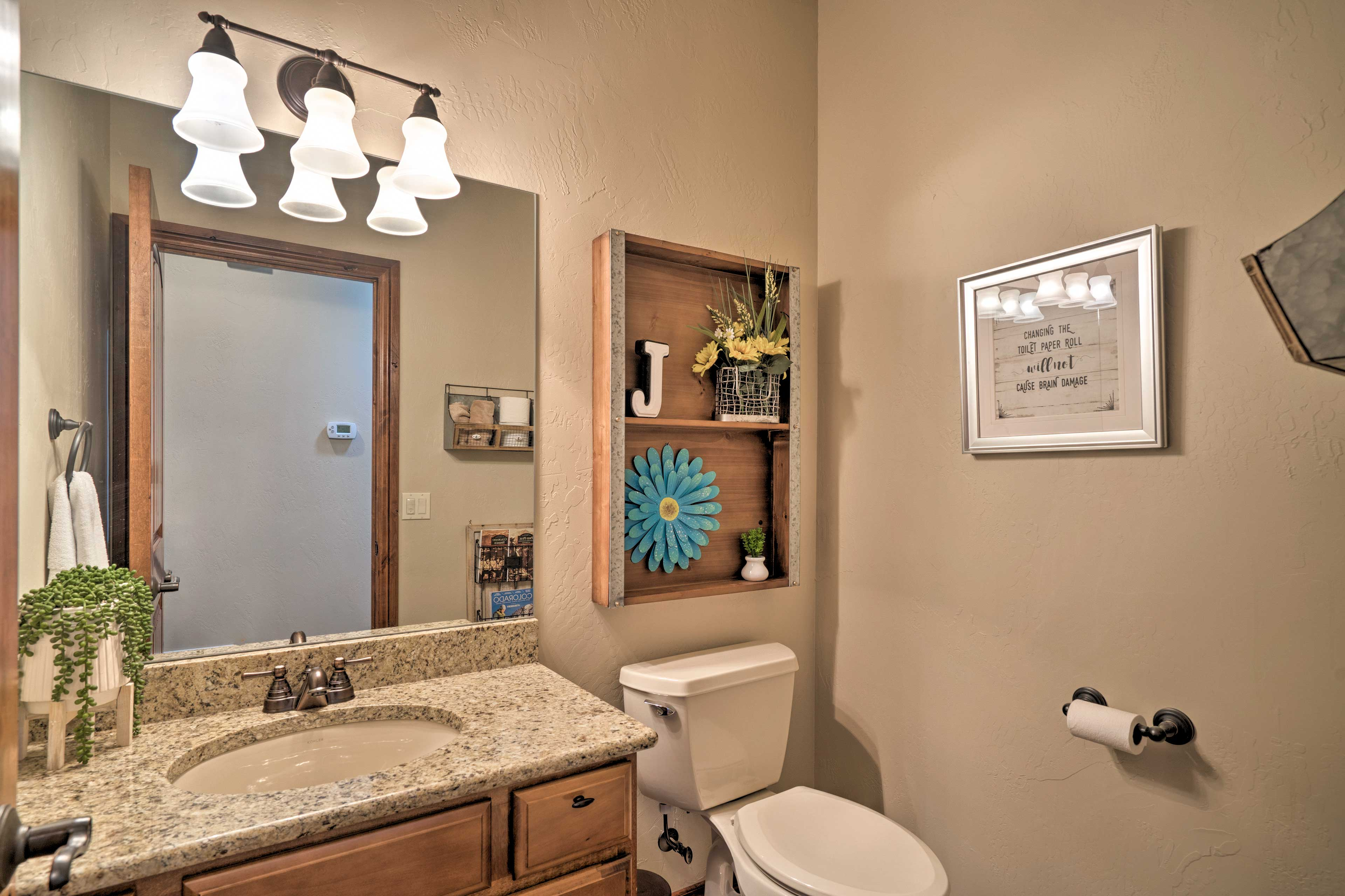 The home features 3 full baths and 1 half bathroom.