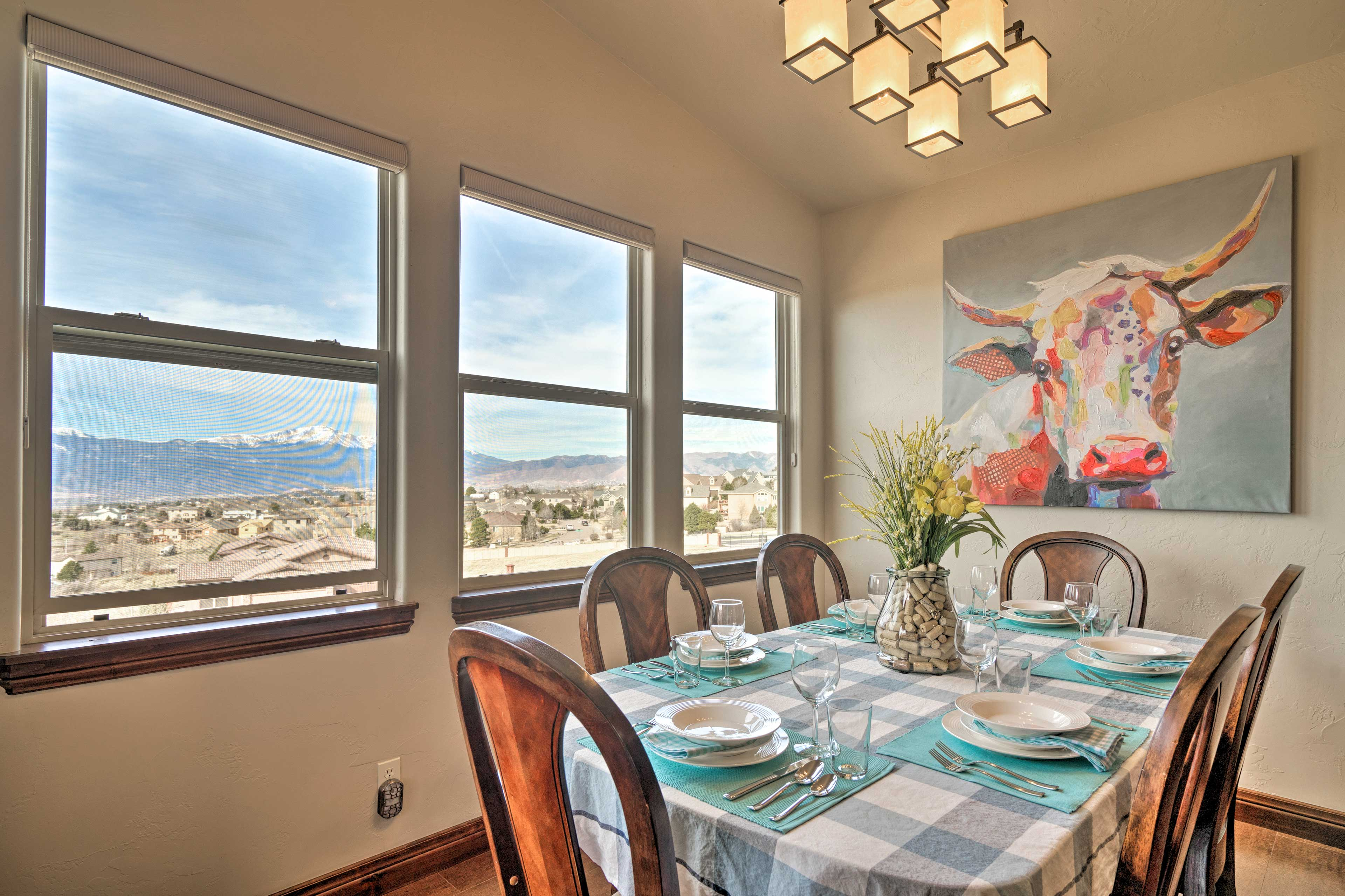 Admire views of Pikes Peak from the 6-seat dining table.
