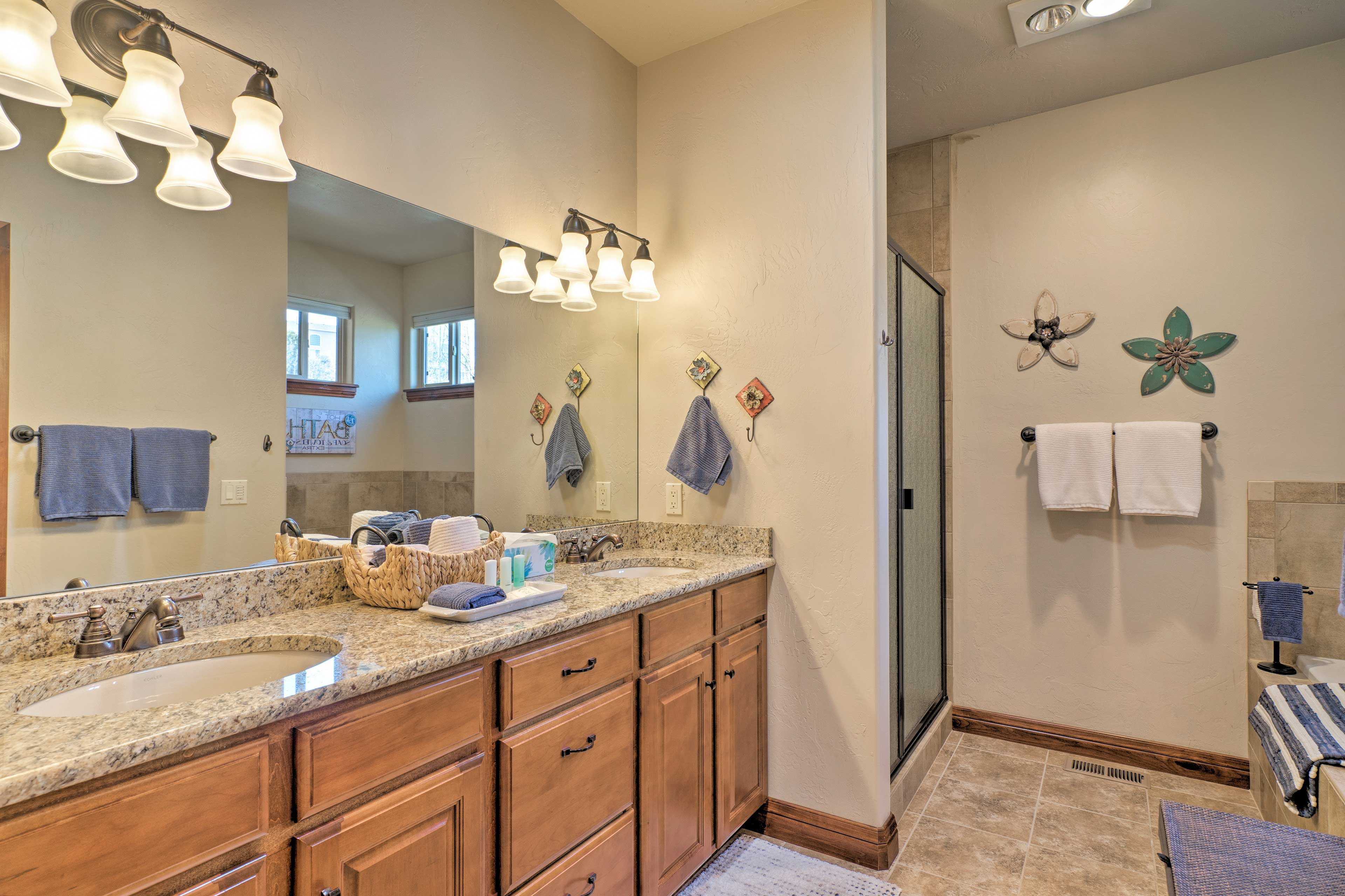 The master's en-suite bath features a dual-sink vanity, tub, and walk-in shower.