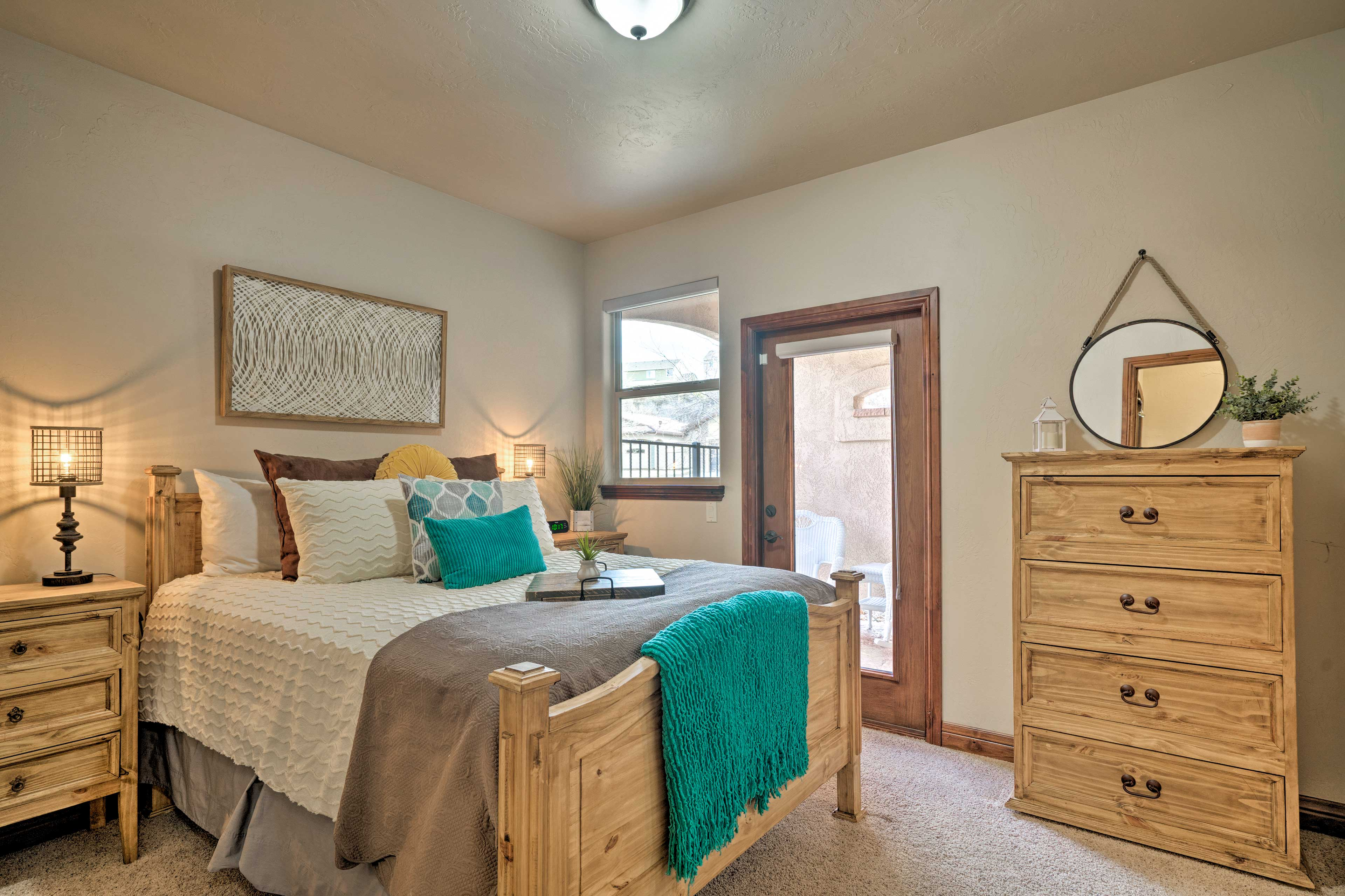 The 2nd master bedroom includes a queen bed and private patio entrance.