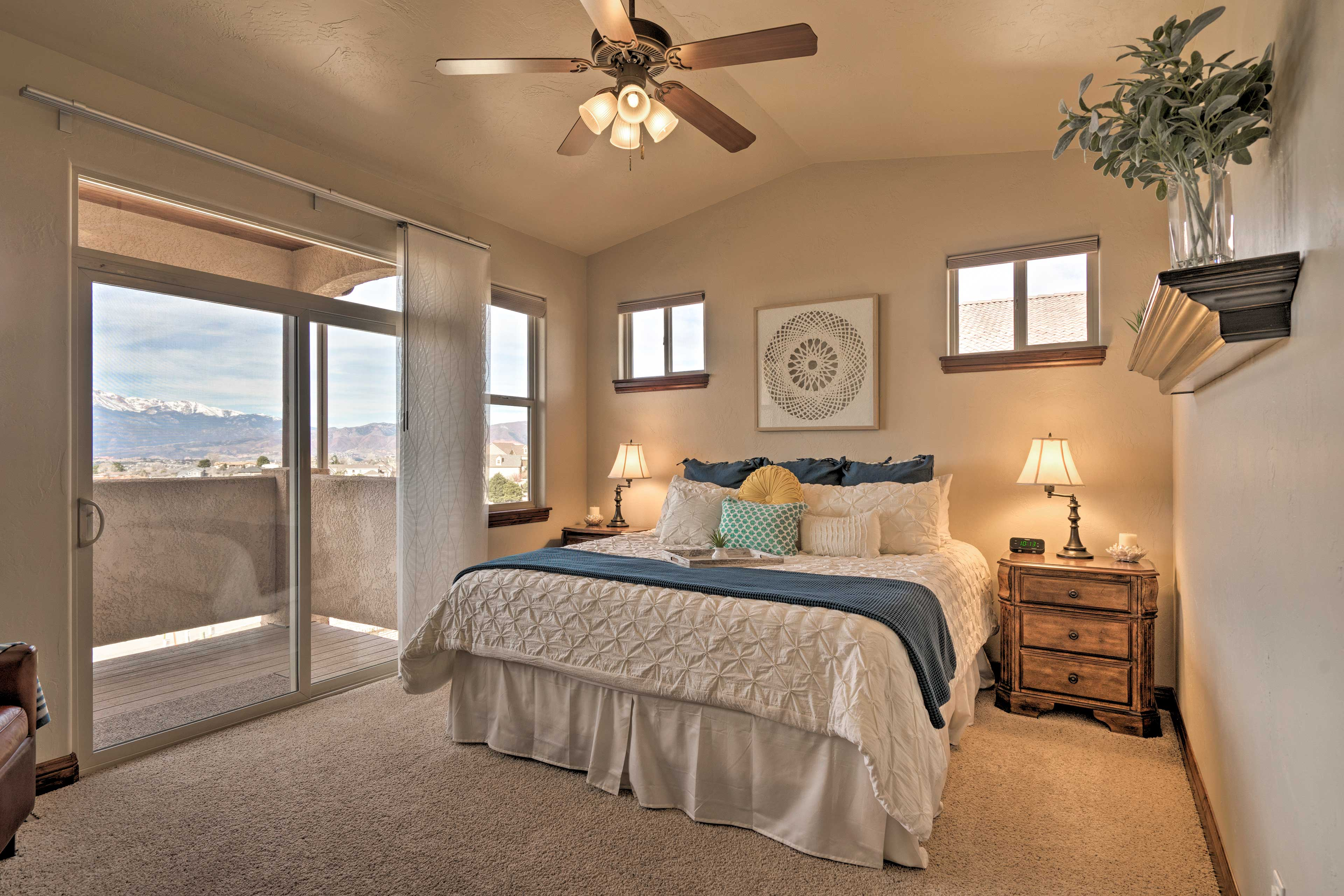 The master bedroom boasts a king bed and private mountain-view balcony.