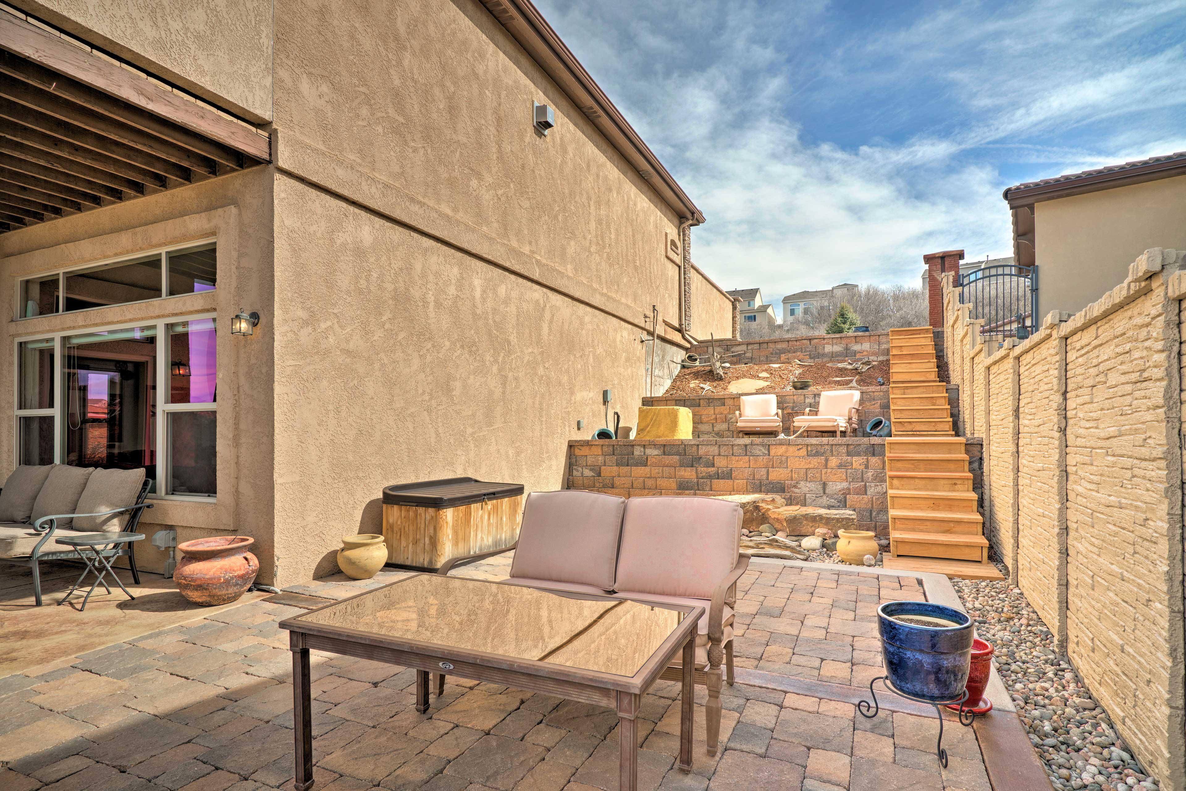 Descend the steps to the spacious garden-level patio.