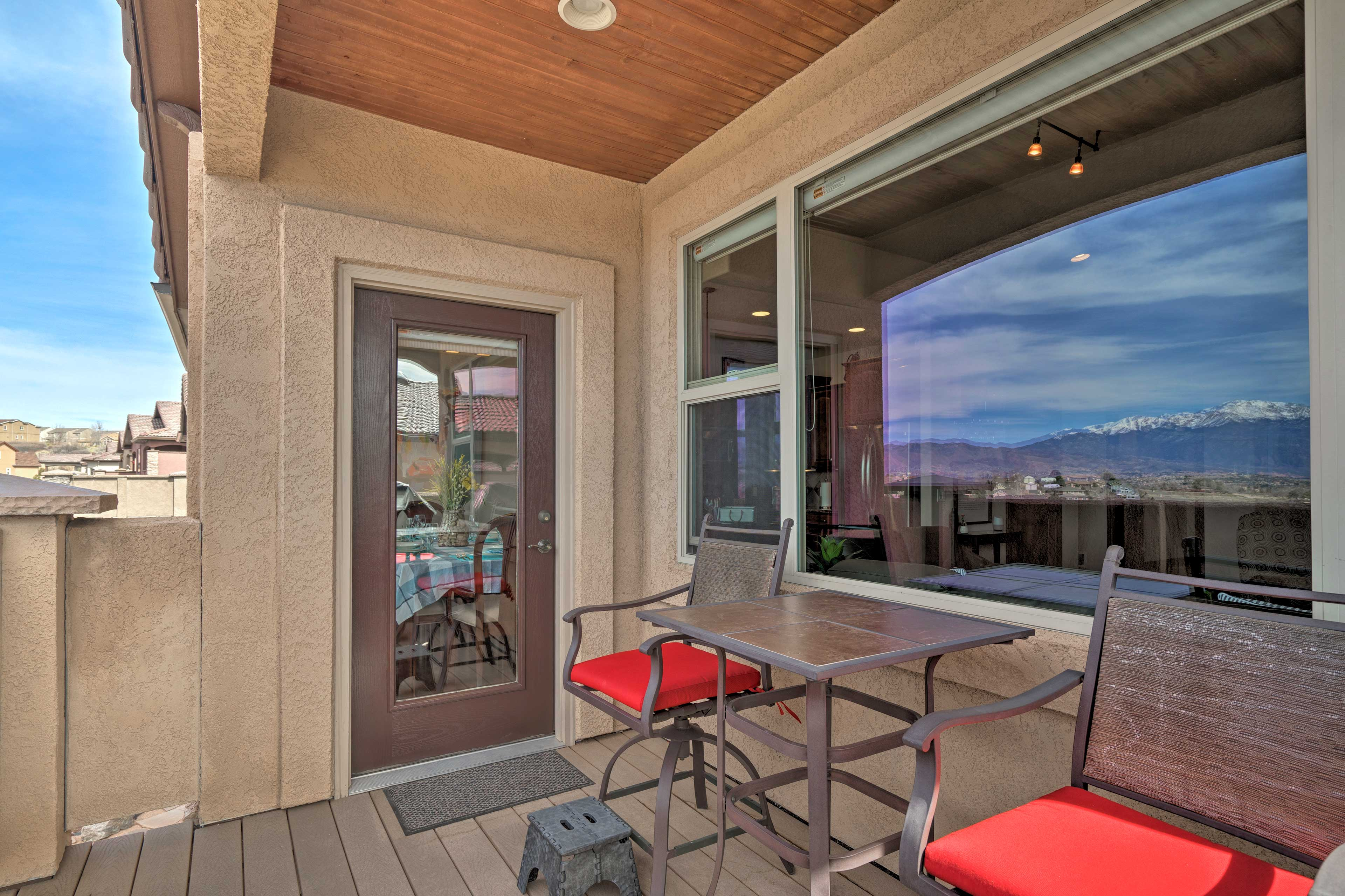 Upstairs, a mountain-view patio sits right off the kitchen and dining area.