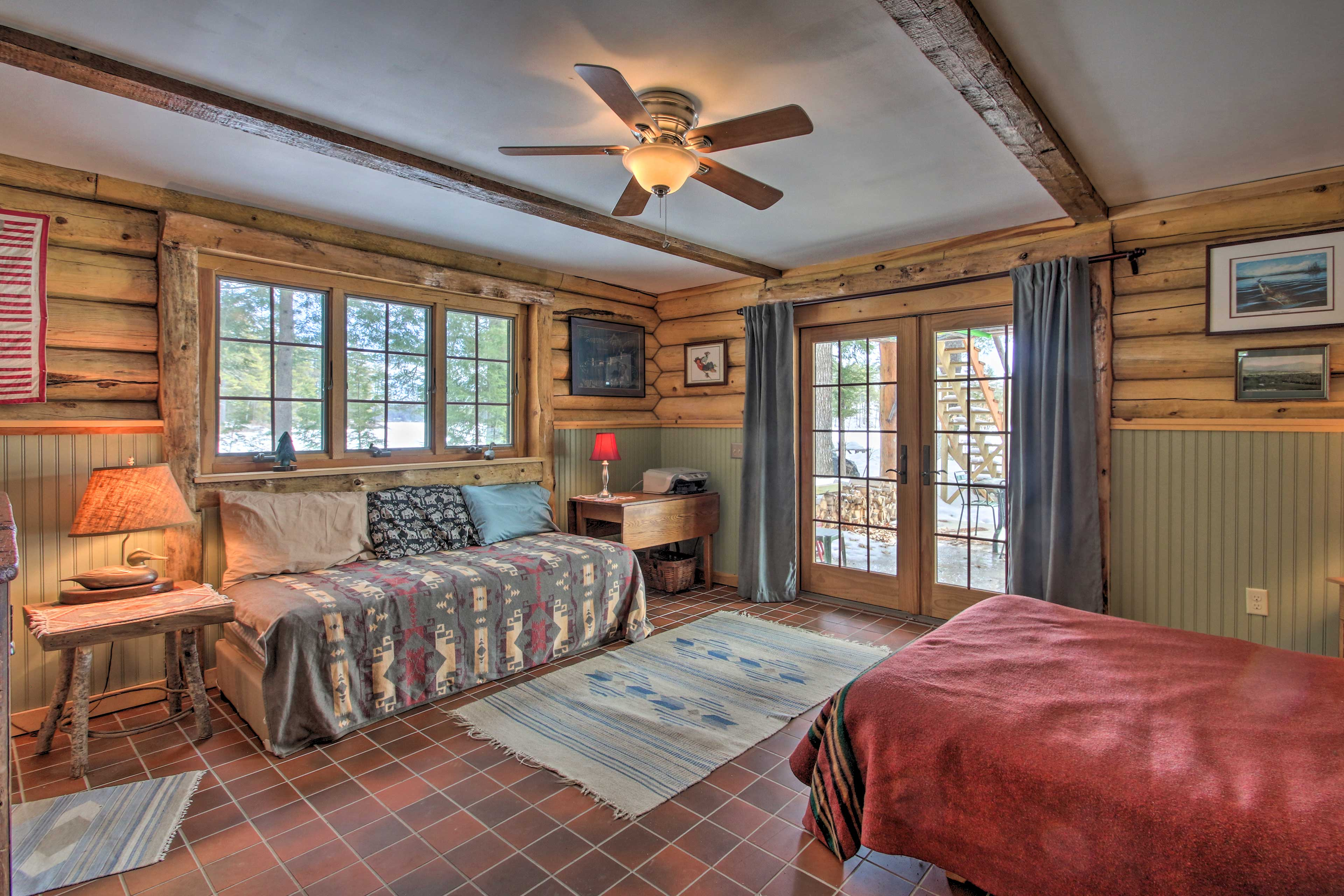 This bedroom is home to a twin and queen bed.