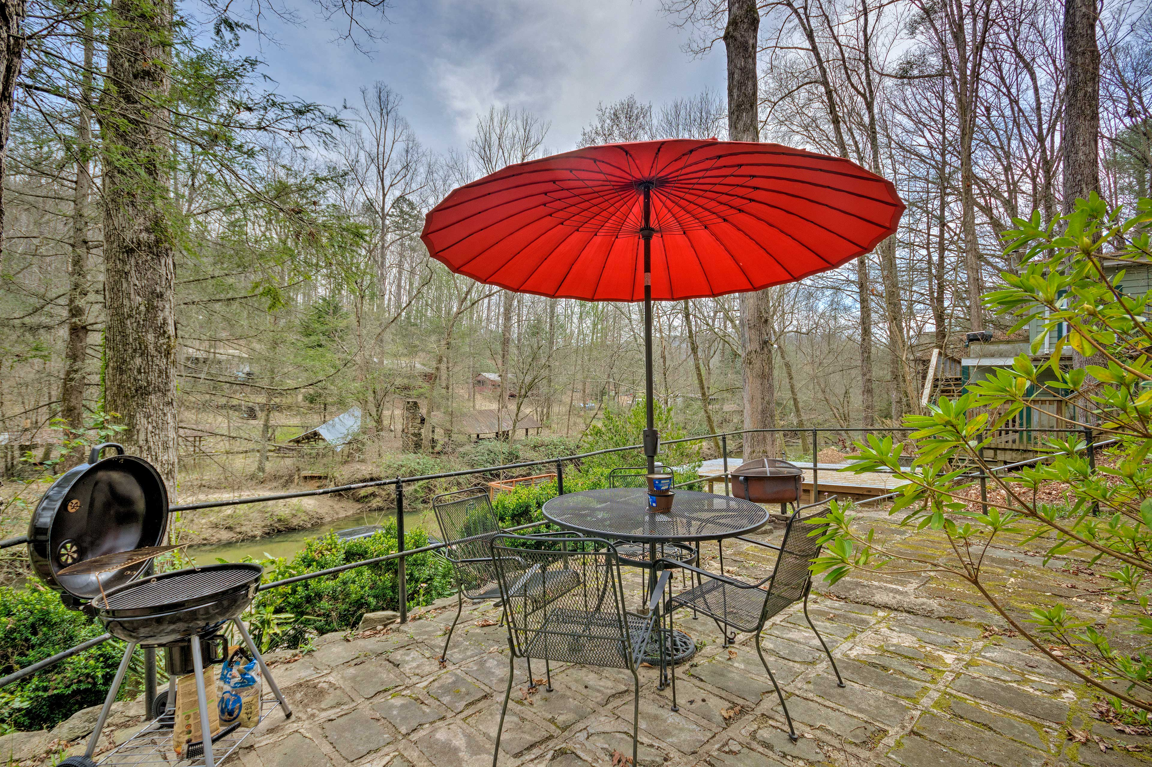 The patio also features a charcoal grill and a fire pit!
