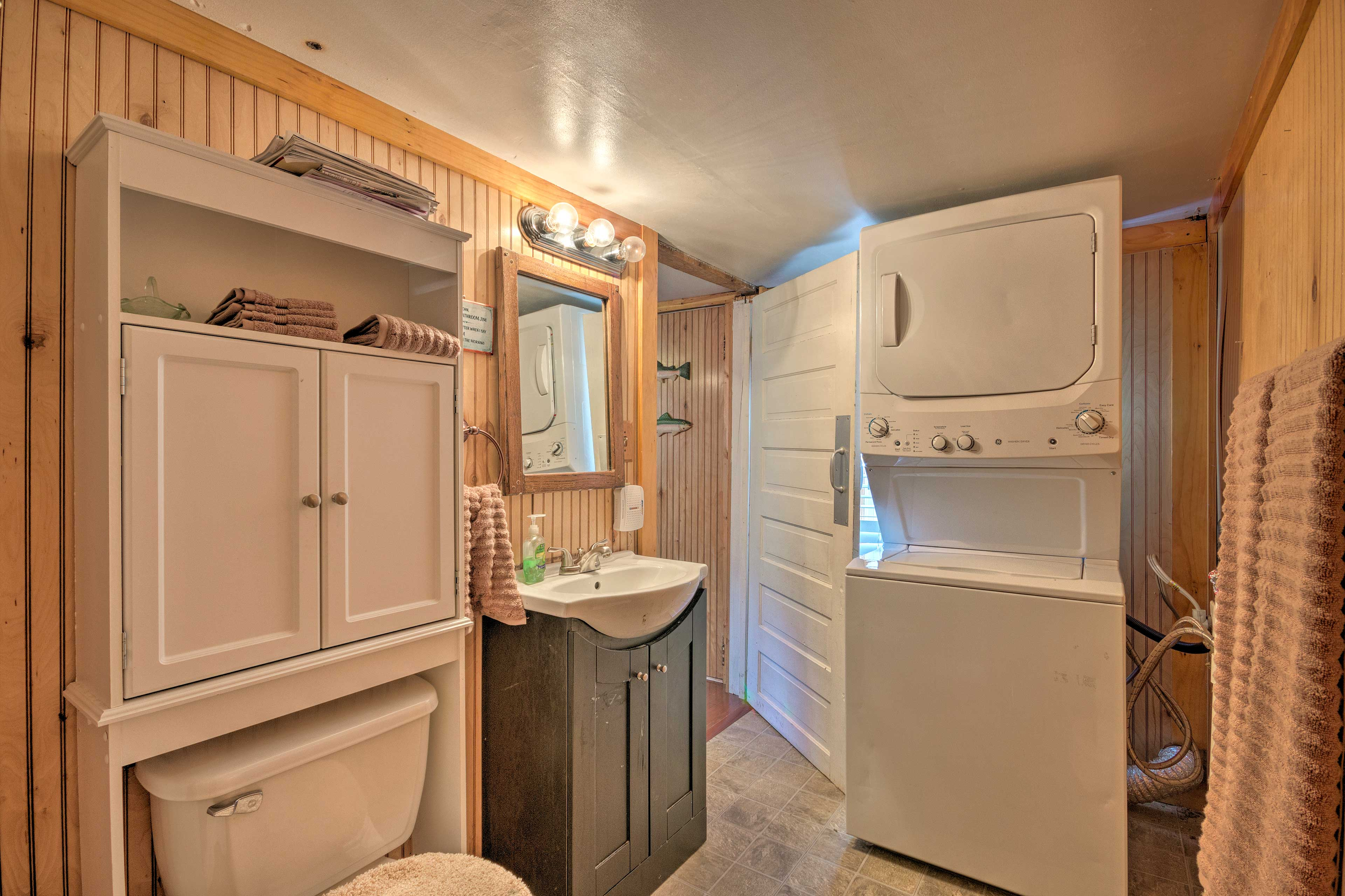 The bathroom also boasts a washer and dryer!