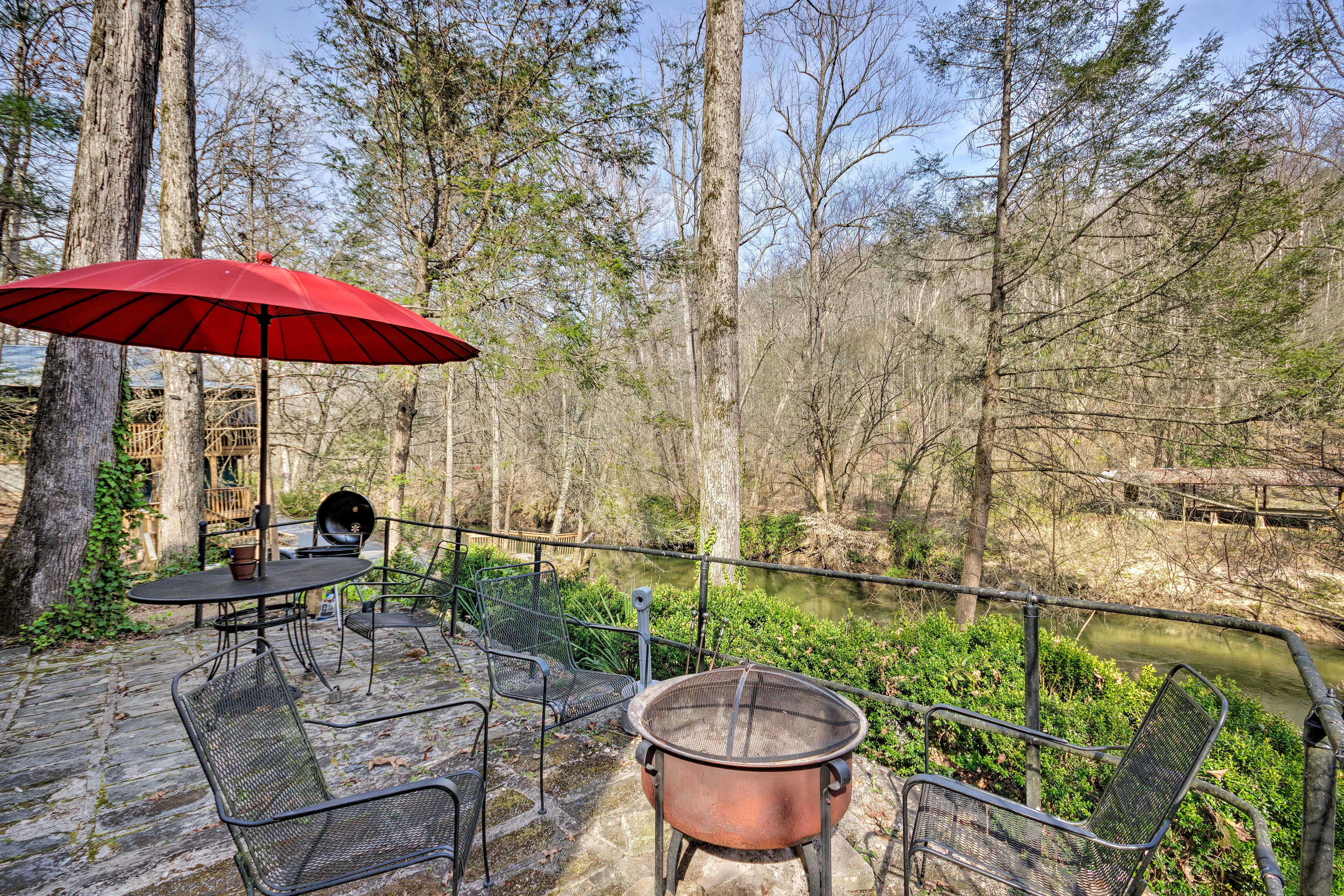 Unwind on the stone terrace at this Cleveland vacation rental!