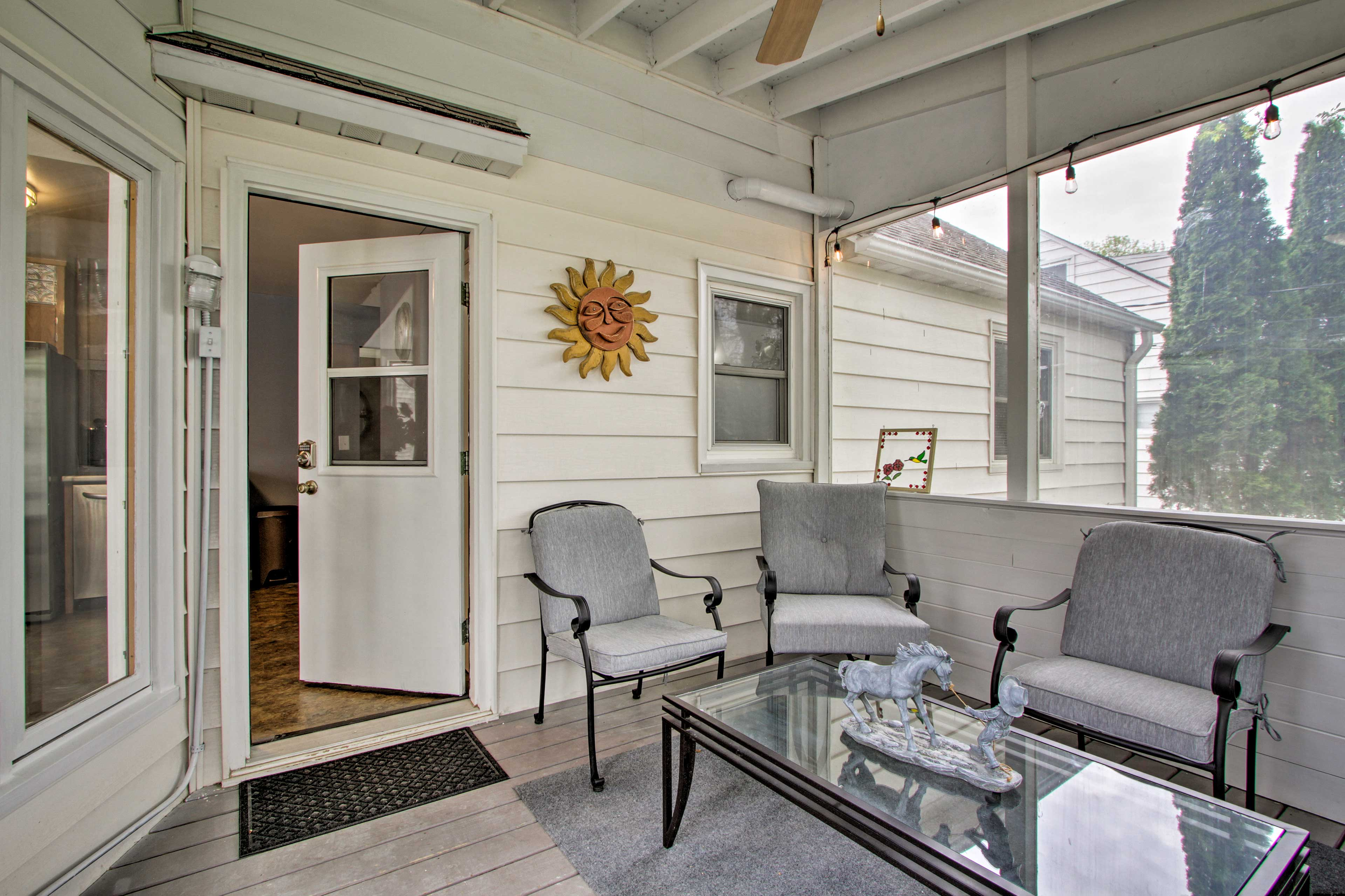 Catch some shade and privacy in the screened porch.