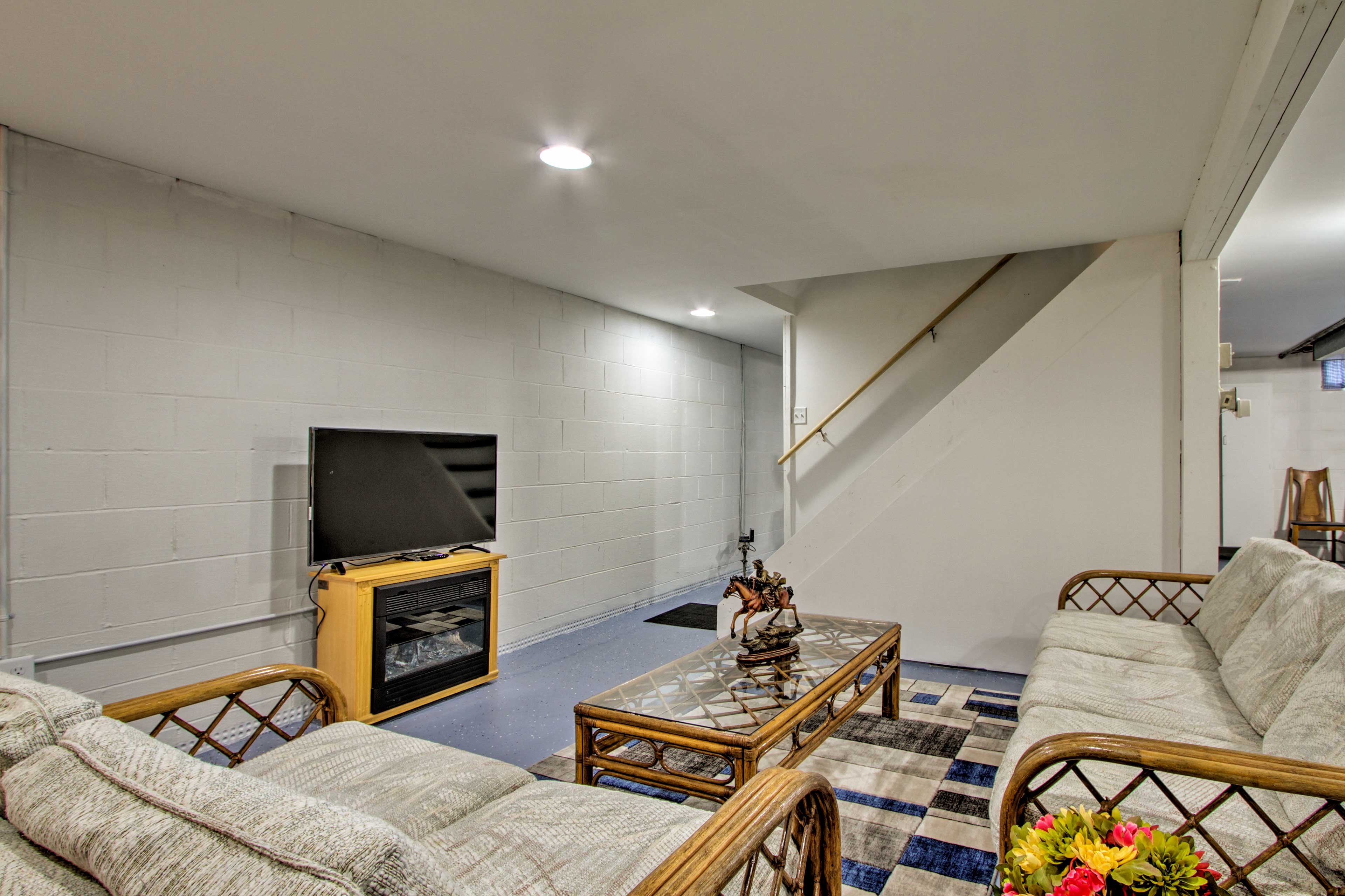 The finished basement includes a flat-screen TV and electric fireplace.