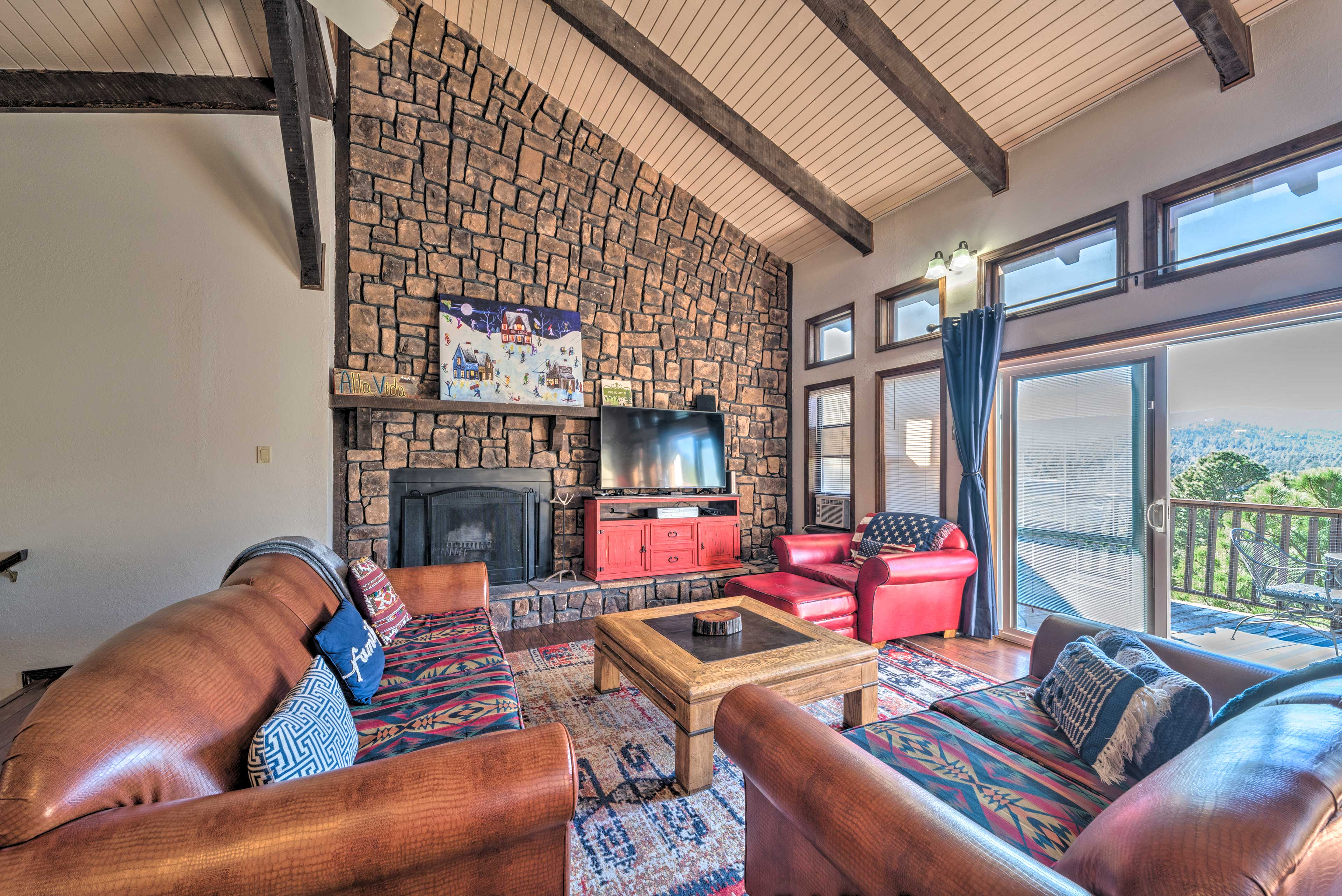 Living Room | High Ceilings | Wood-Burning Fireplace