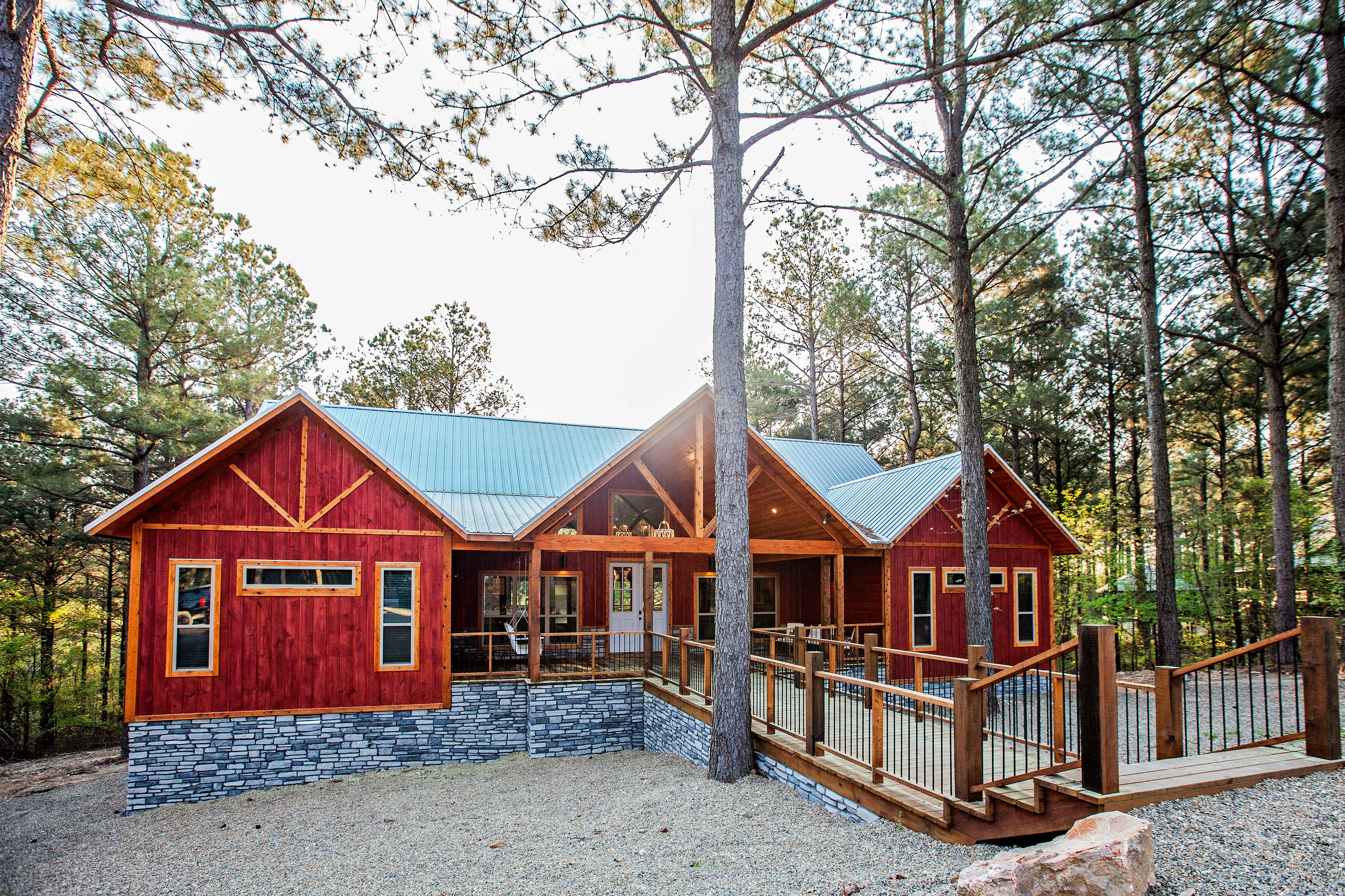 The cabin features elements of contemporary, chic, & rustic styles.
