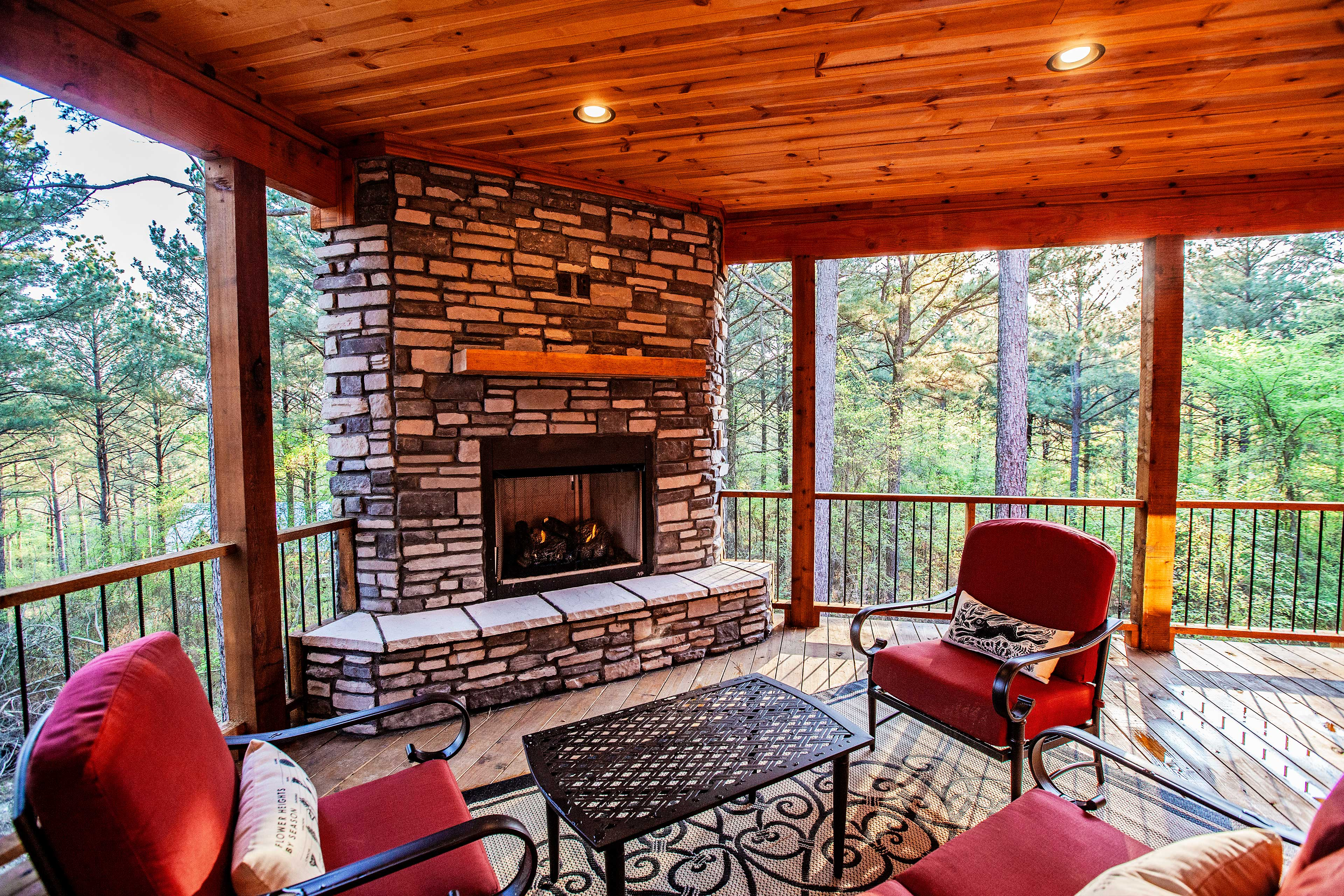 A second fireplace is located outdoors on the deck.