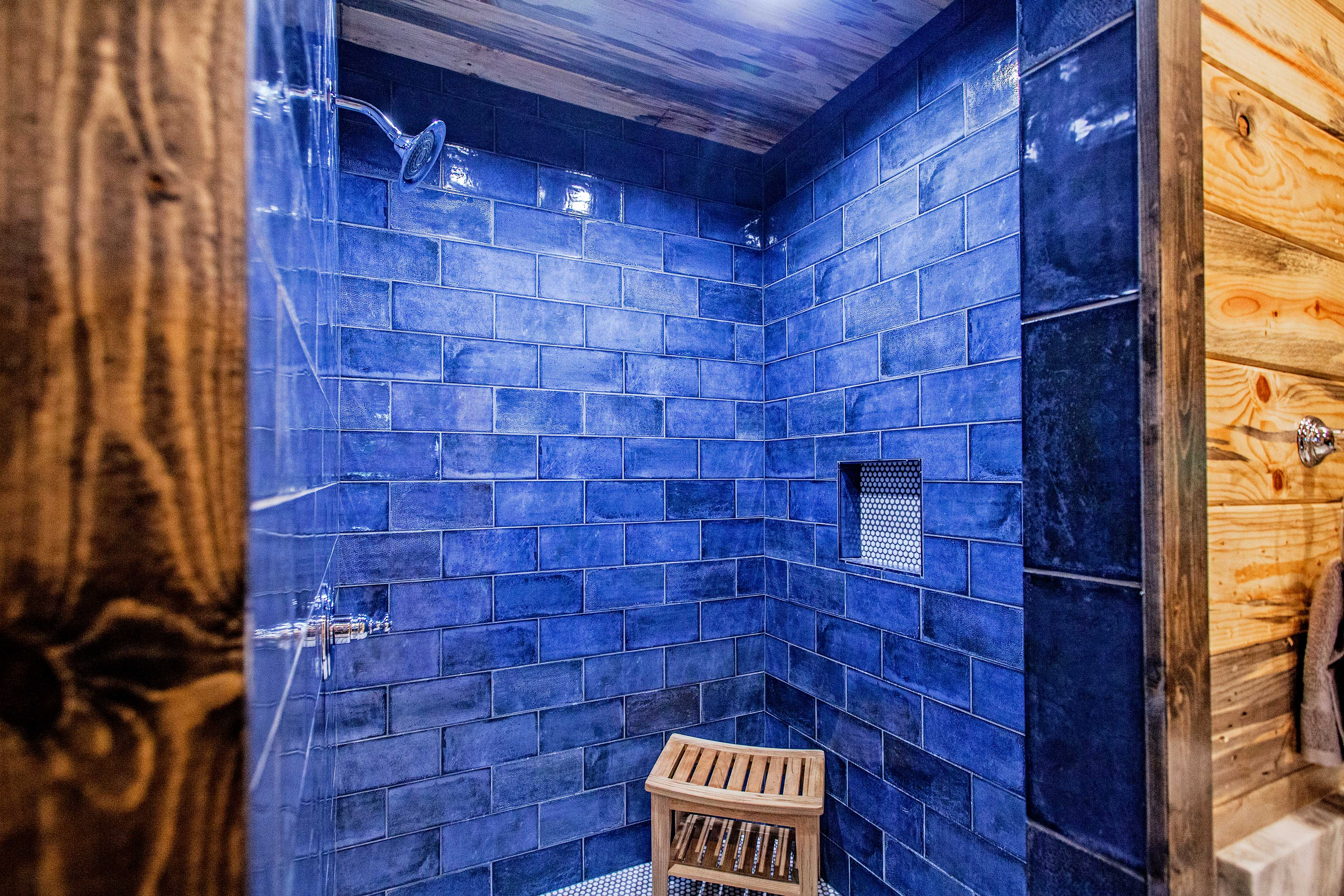 This walk-in shower boasts gorgeous blue tiles.