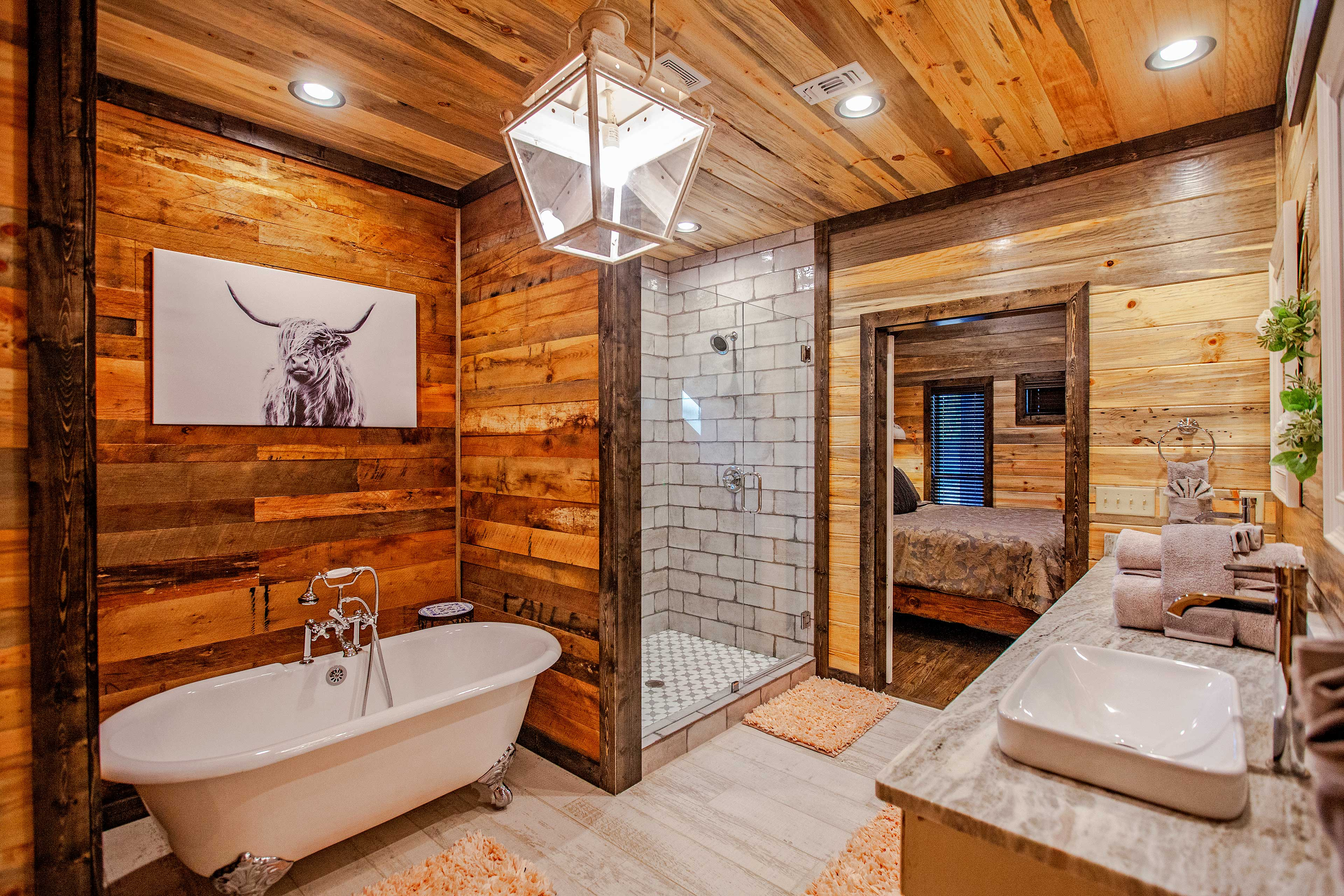 Rinse off in this lavish walk-in shower with glass doors.